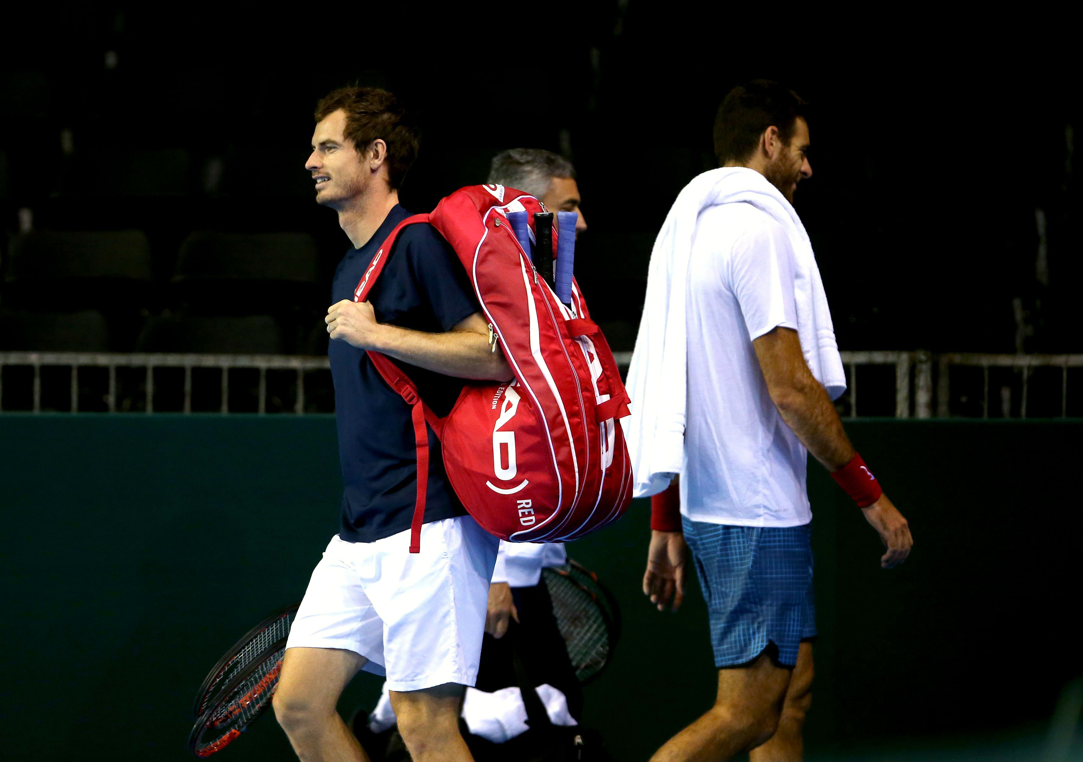 Britain's Andy Murray, left, walks on the court as Argentina's Juan Martin del Potro walks off  during training session at the Emirates Arena, Glasgow Scotland Thursday Sept.15, 2016. Britain play against Argentina a Davis Cup semifinal match starting Fri