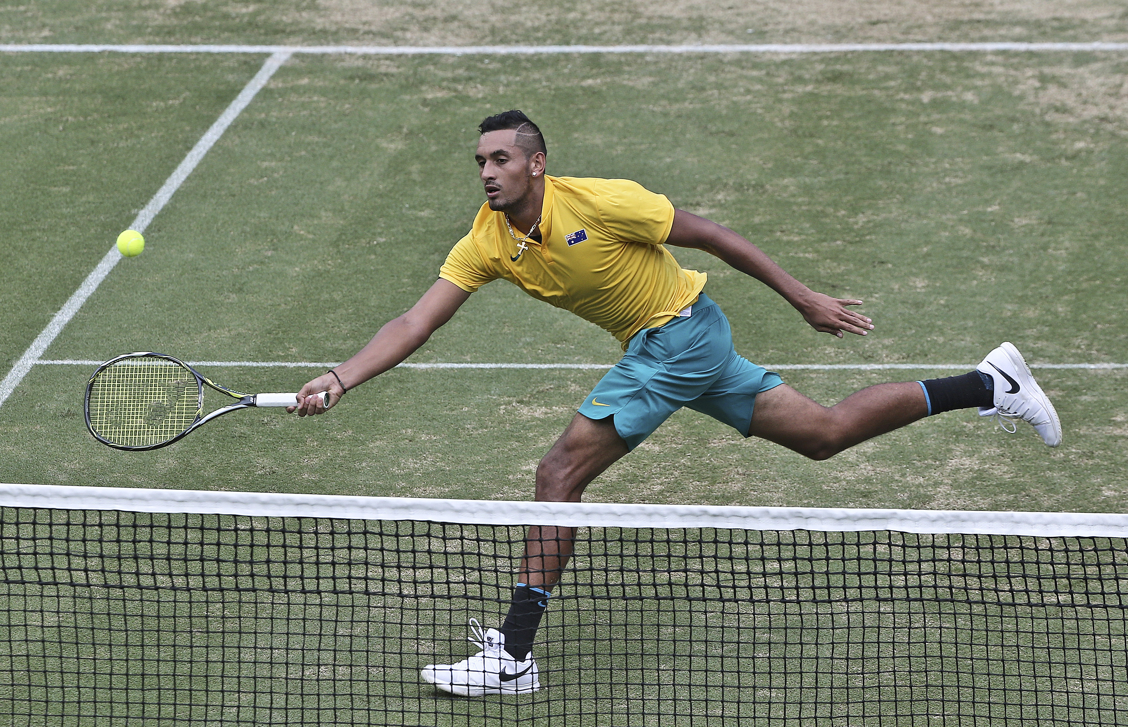 Australia's Nick Kyrgios plays a forehand shot at the net in his Davis Cup tennis tie against Slovakia's Andrej Martin in Sydney Friday, Sept. 16, 2016. Kyrgios won the match 3-0. (AP Photo/Rob Griffith)