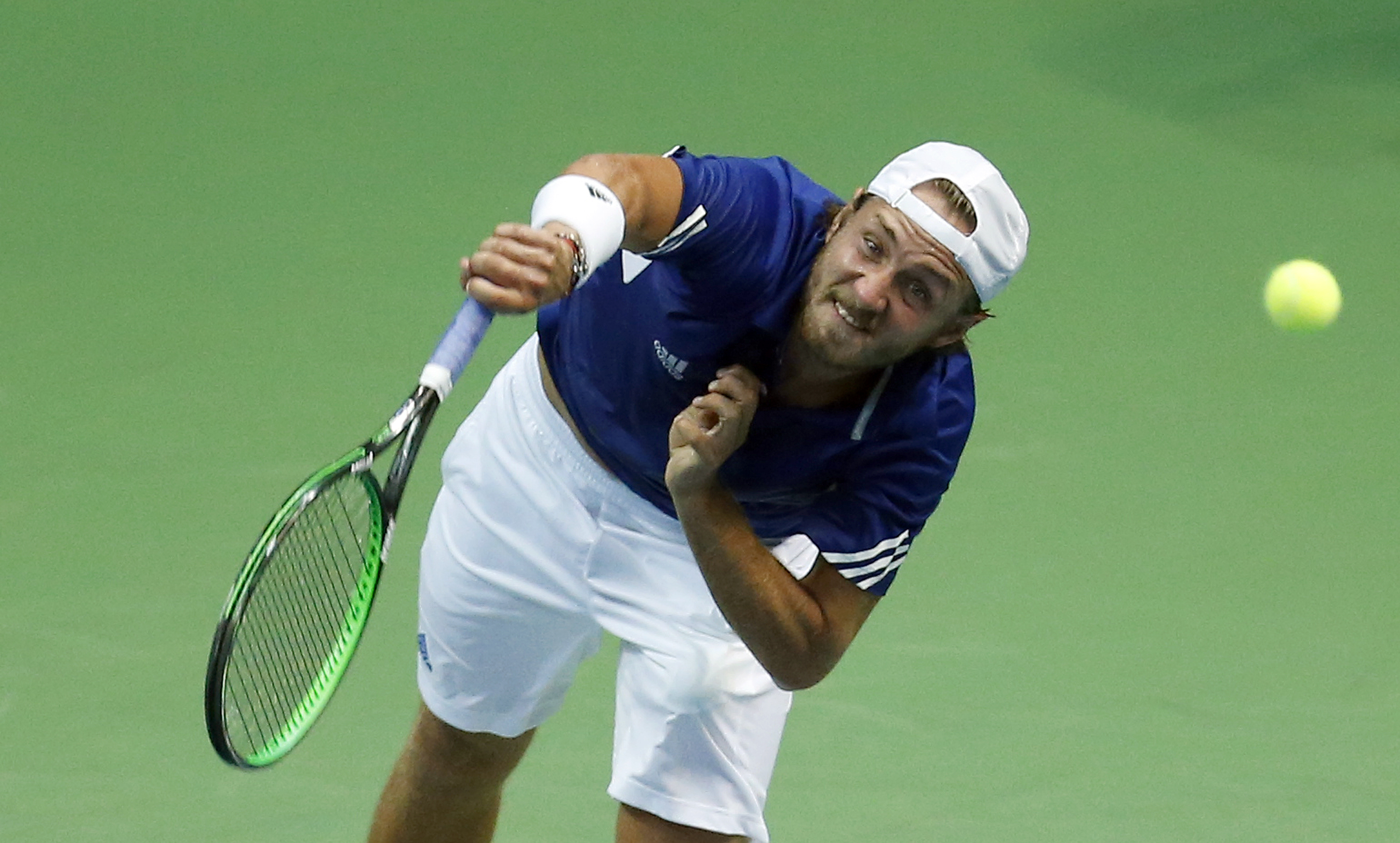 France's Lucas Pouille serves to Croatia's Marin Cilic during the Davis Cup semifinal tennis match between Croatia and France, in Zadar, Croatia, Friday, Sept. 16, 2016. (AP Photo/Darko Bandic)