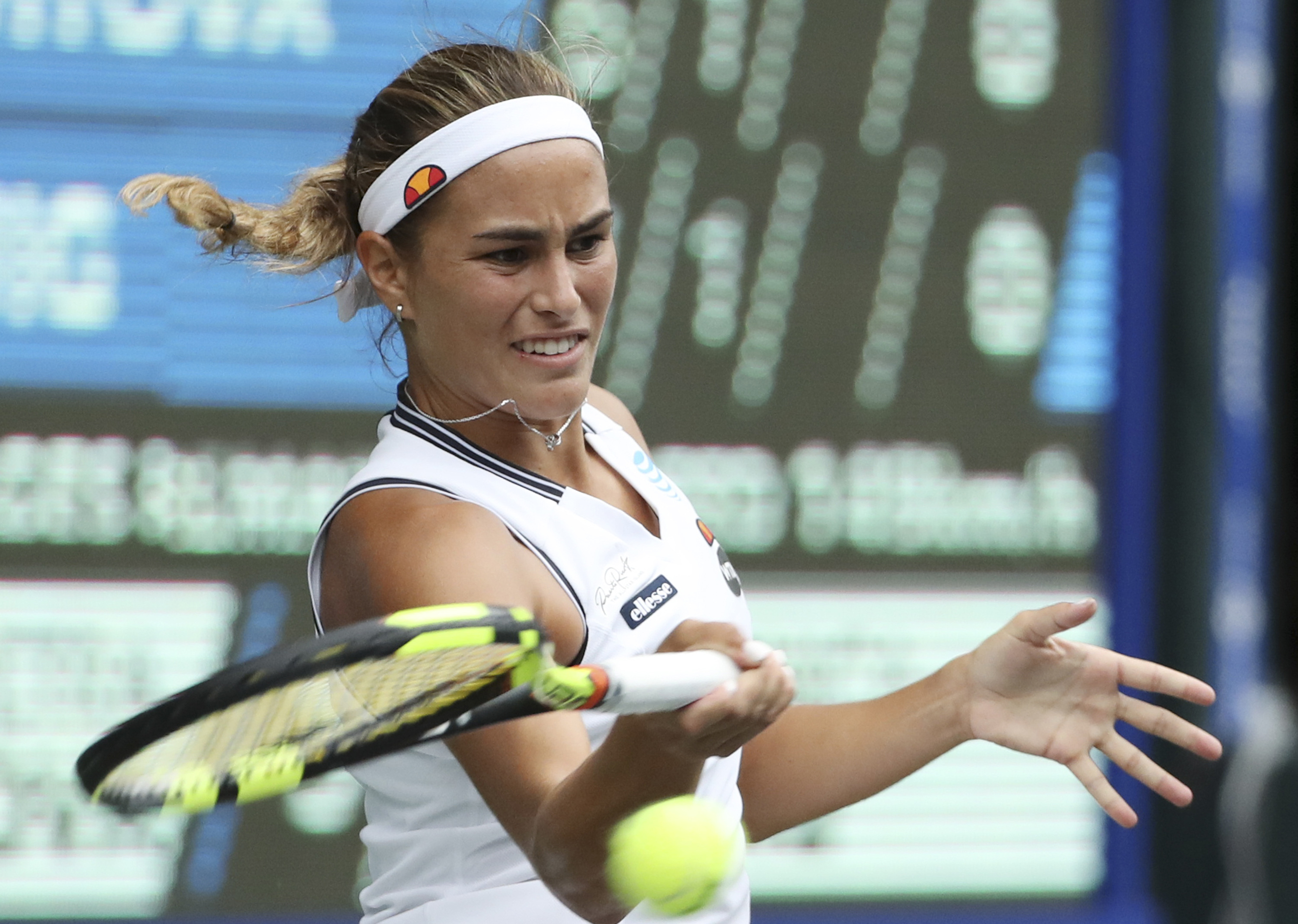 Monica Puig, of Puerto Rico, returns a shot against Petra Kvitova, of the Czech Republic, during the women's singles match at the Pan Pacific Open women's tennis tournament in Tokyo, Wednesday, Sept. 21, 2016. (AP Photo/Eugene Hoshiko)