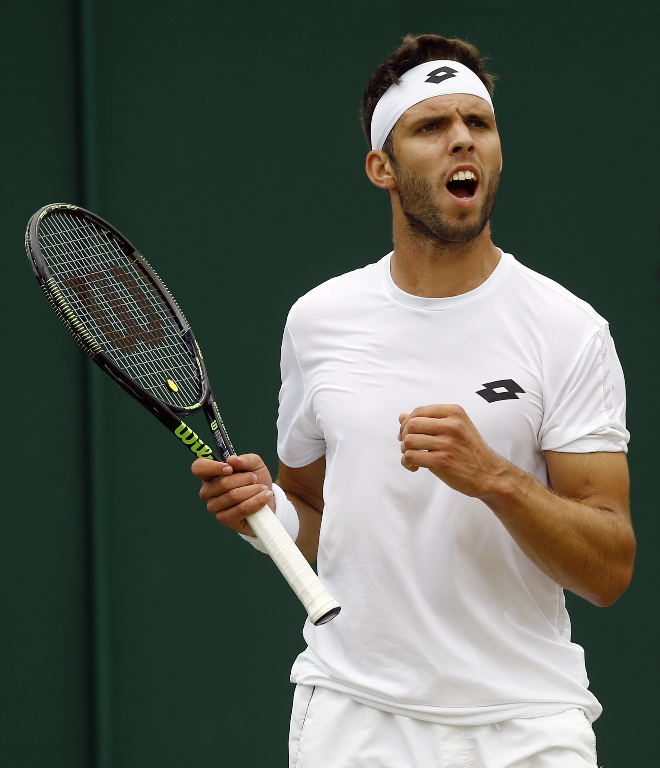 Jiri Vesely of the Czech Republic celebrates a point against Tomas Berdych of the Czech Republic during their men's singles match on day nine of the Wimbledon Tennis Championships in London, Tuesday, July 5, 2016. (AP Photo/Kirsty Wigglesworth)
