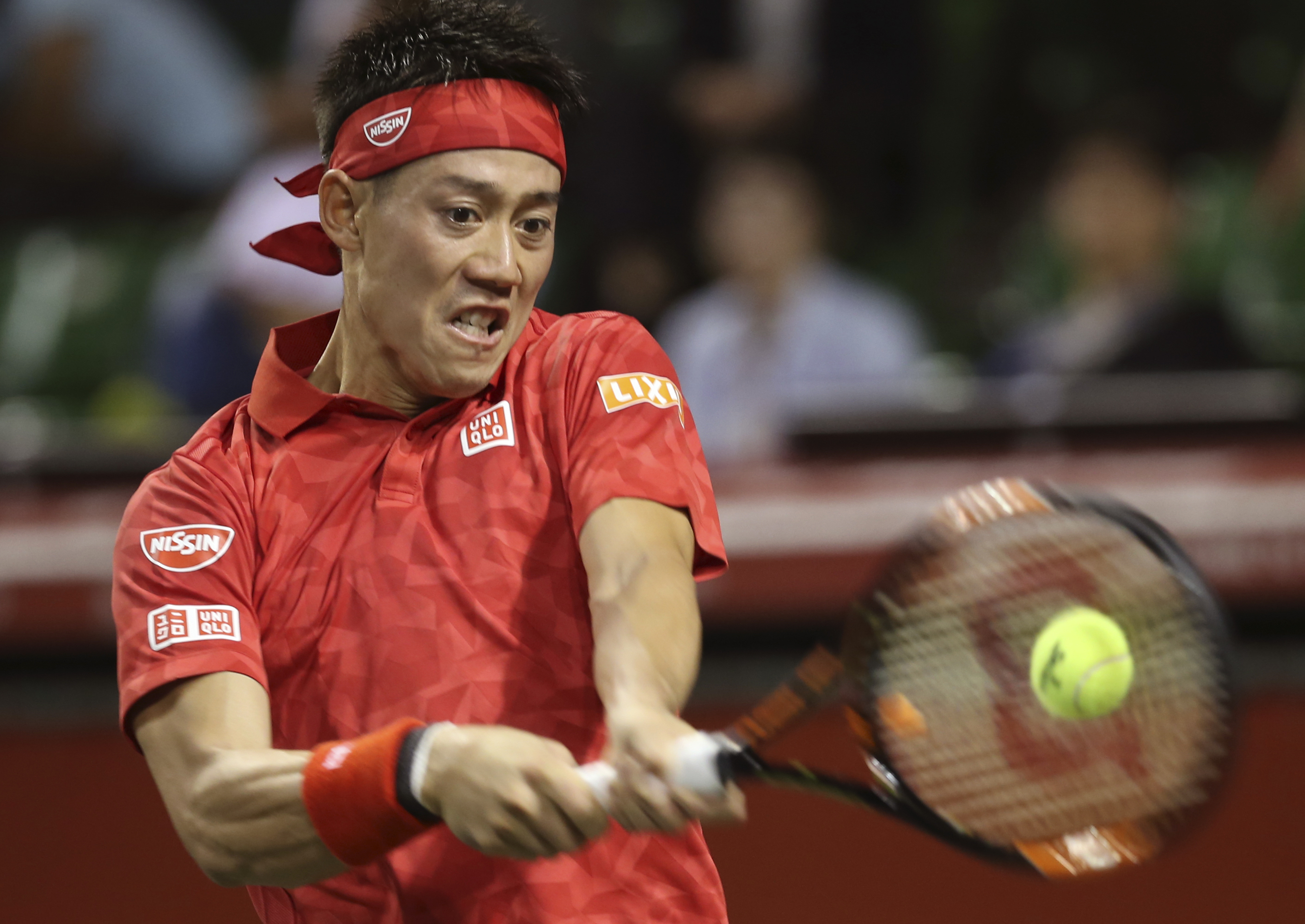 Japan's Kei Nishikori returns a shot against Donald Young of the United States during the first round match of Japan Open tennis championships in Tokyo, Monday, Oct. 3, 2016. (AP Photo/Koji Sasahara)