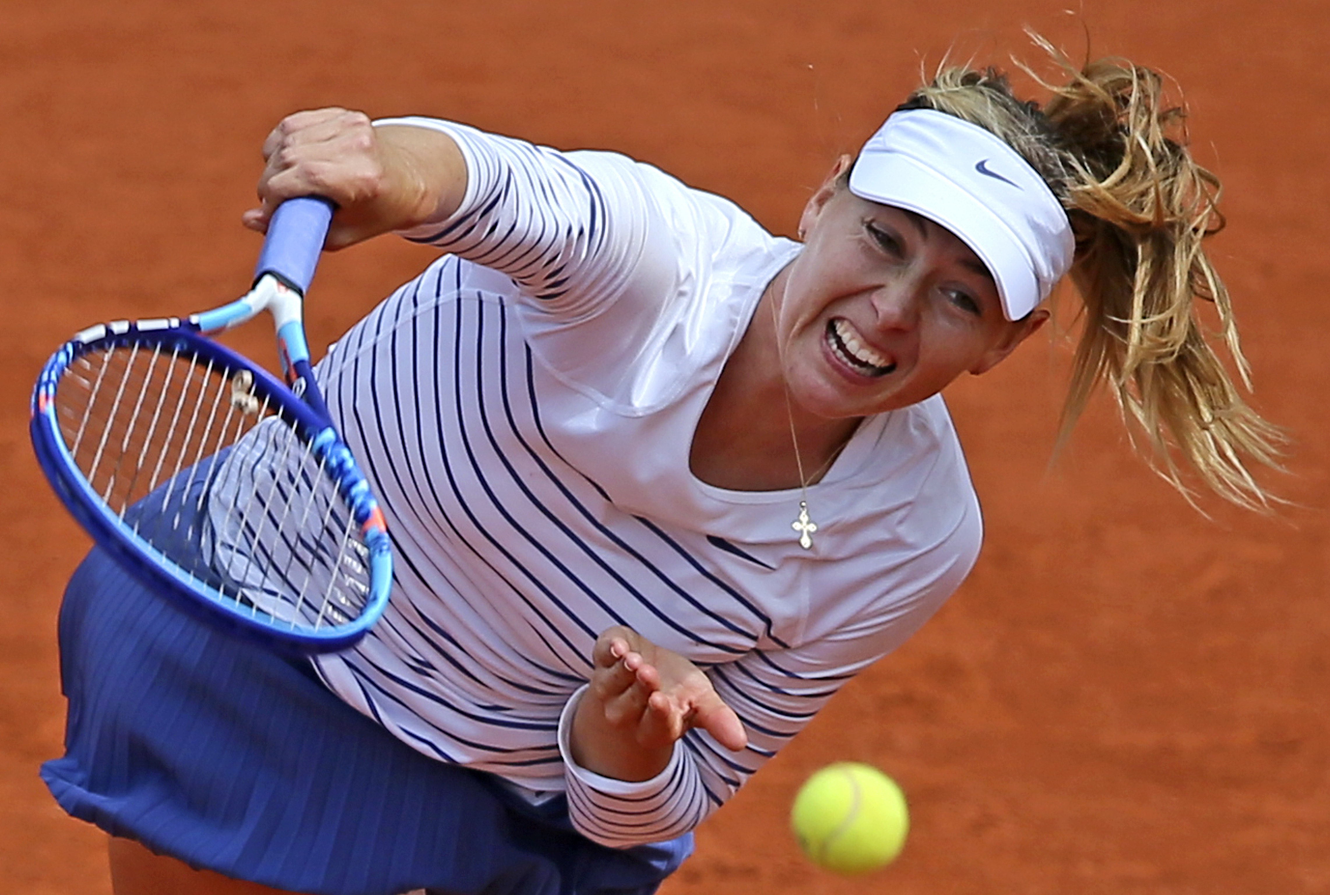 FILE - In this June 1, 2015, file photo, Russia's Maria Sharapova serves the ball to Lucie Safarova of the Czech Republic during a fourth round match of the French Open tennis tournament at Roland Garros Stadium in Paris, France. The highest court in spor