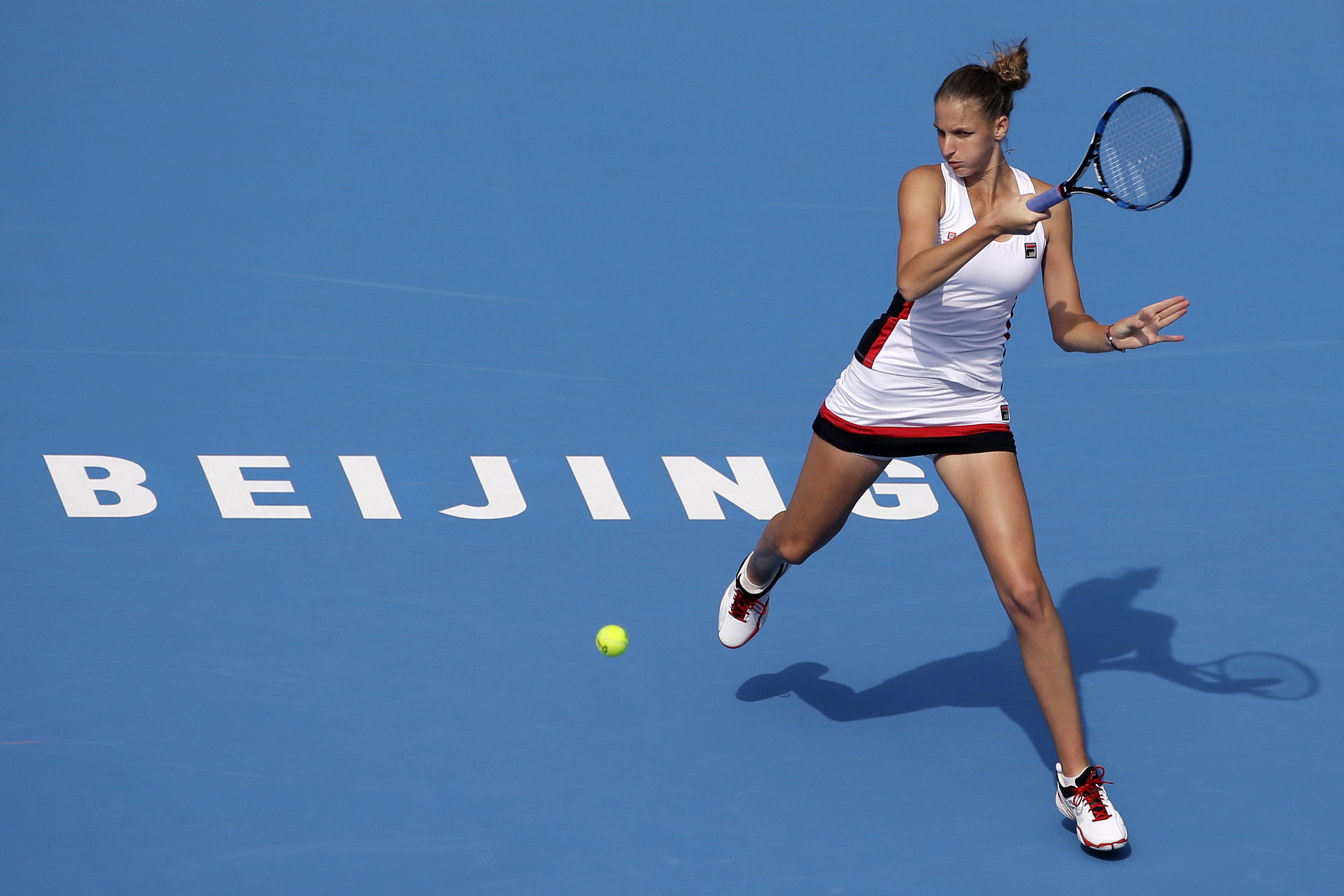 Karolina Pliskova of the Czech Republic hits a return shot against Daria Kasatkina of Russia during their women's singles match of the China Open tennis tournament at the Lotus Court in Beijing, Wednesday, Oct. 5, 2016. (AP Photo/Andy Wong)