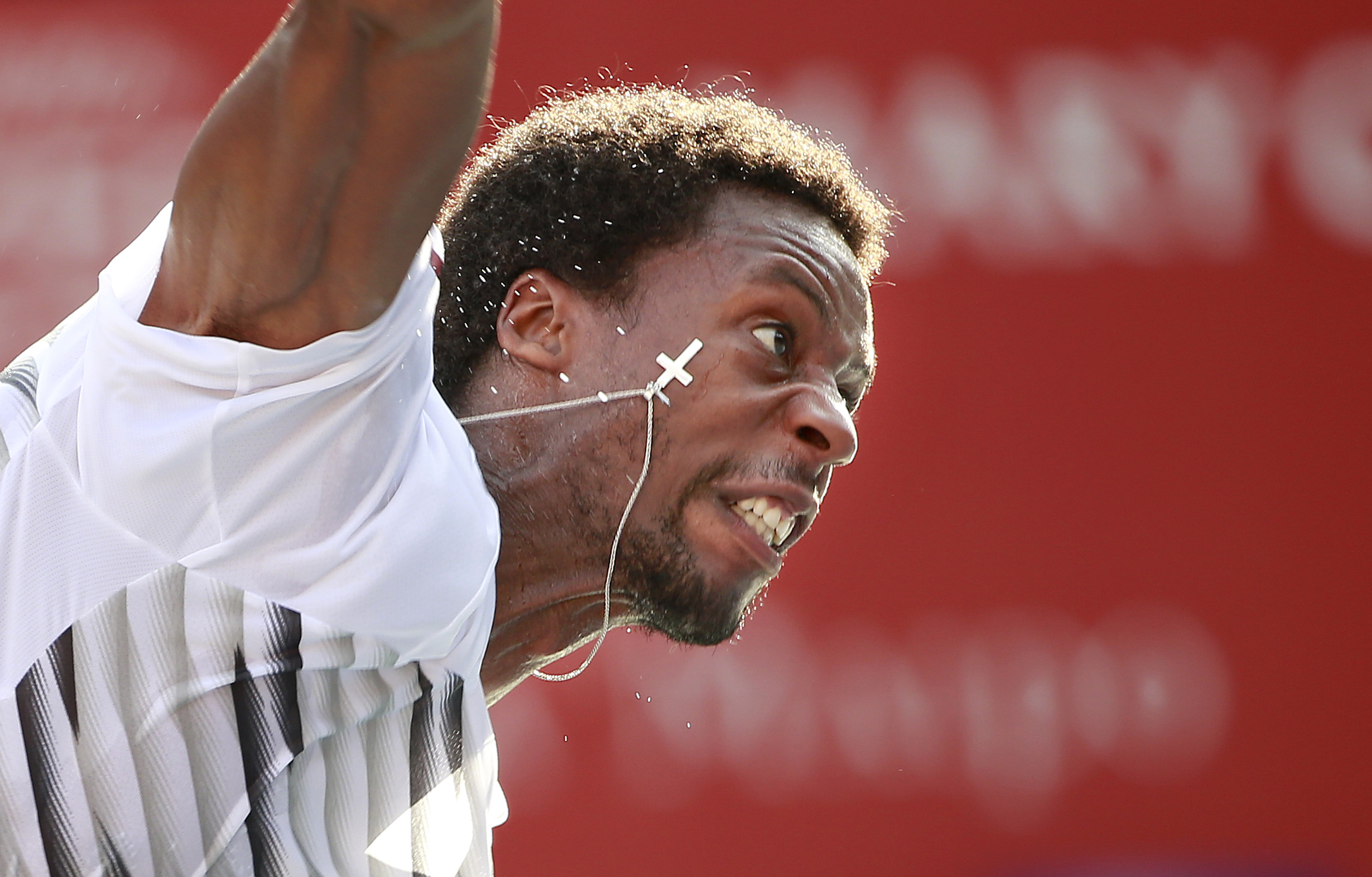 Gael Monfils of France serves to Gilles Simon of France during their second round match of the Japan Open tennis tournament in Tokyo, Thursday, Oct. 6, 2016. (AP Photo/Shizuo Kambayashi)
