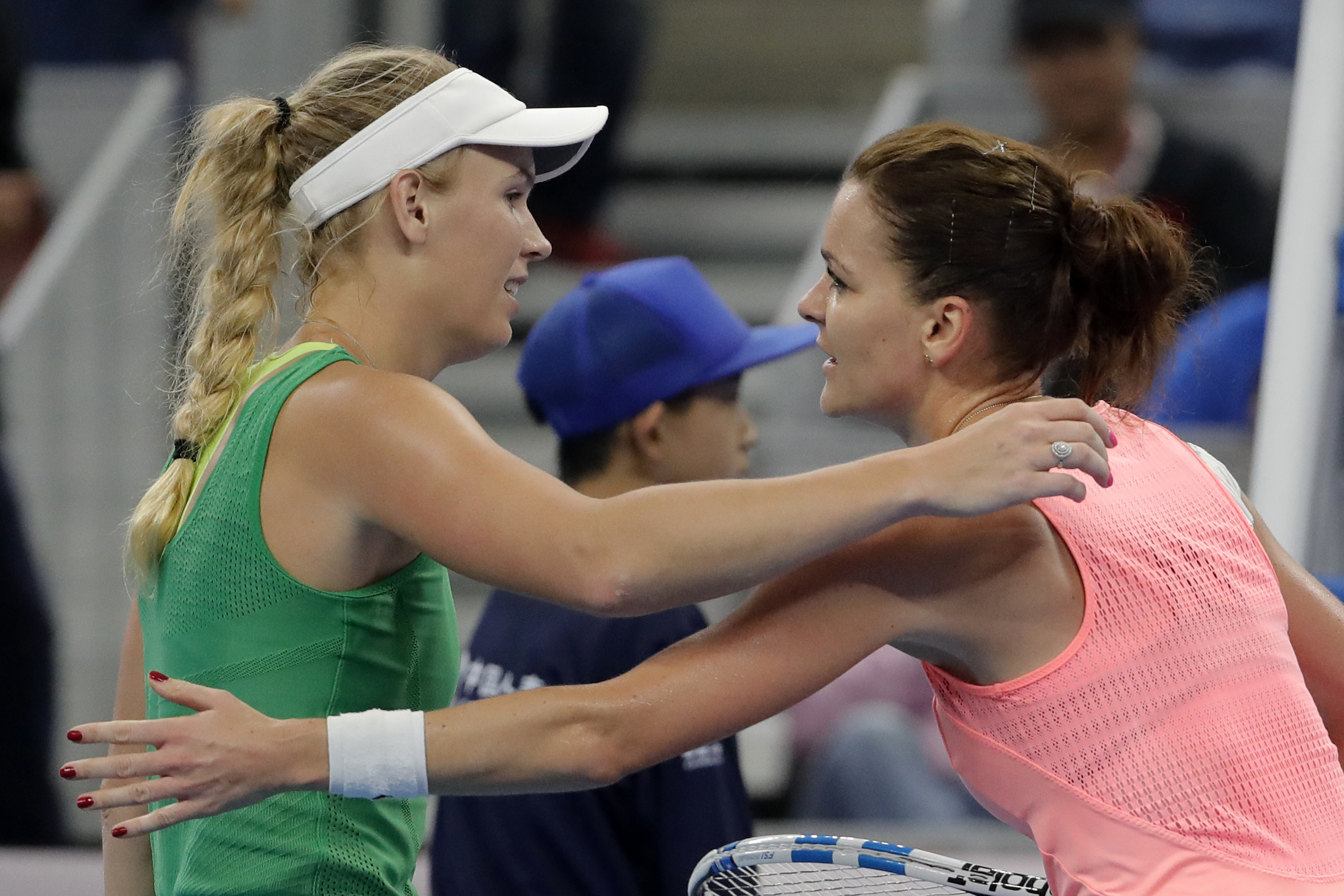 Agnieszka Radwanska of Poland, right, hugs with Caroline Wozniacki of Denmark after winning the women's singles of the China Open tennis tournament at the Diamond Court in Beijing, Thursday, Oct. 6, 2016. (AP Photo/Andy Wong)