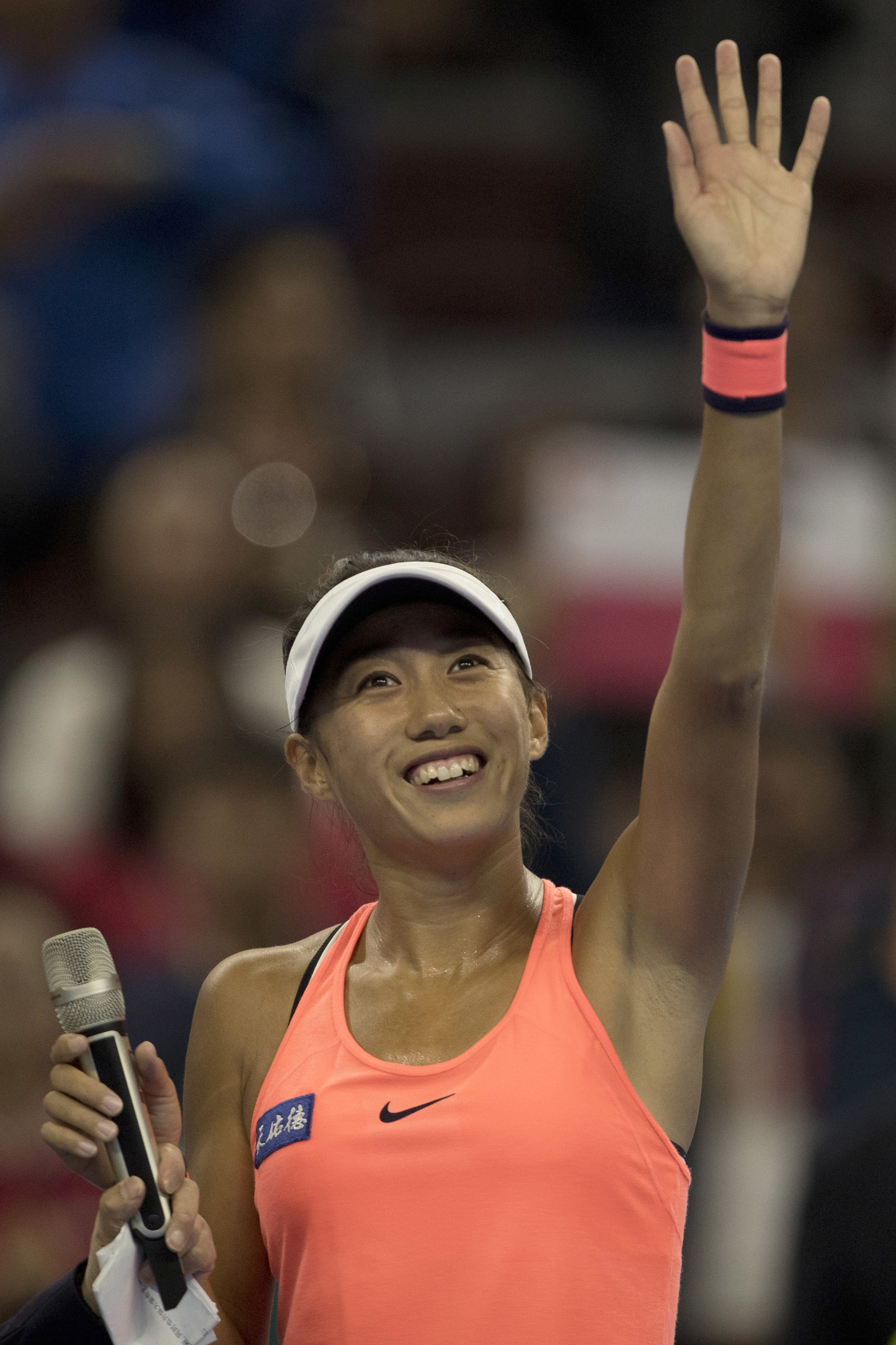 Zhang Shuai of China celebrates after defeating Simona Halep of Romania in a women's singles match of the China Open tennis tournament in Beijing, Thursday, Oct. 6, 2016. (AP Photo/Ng Han Guan)
