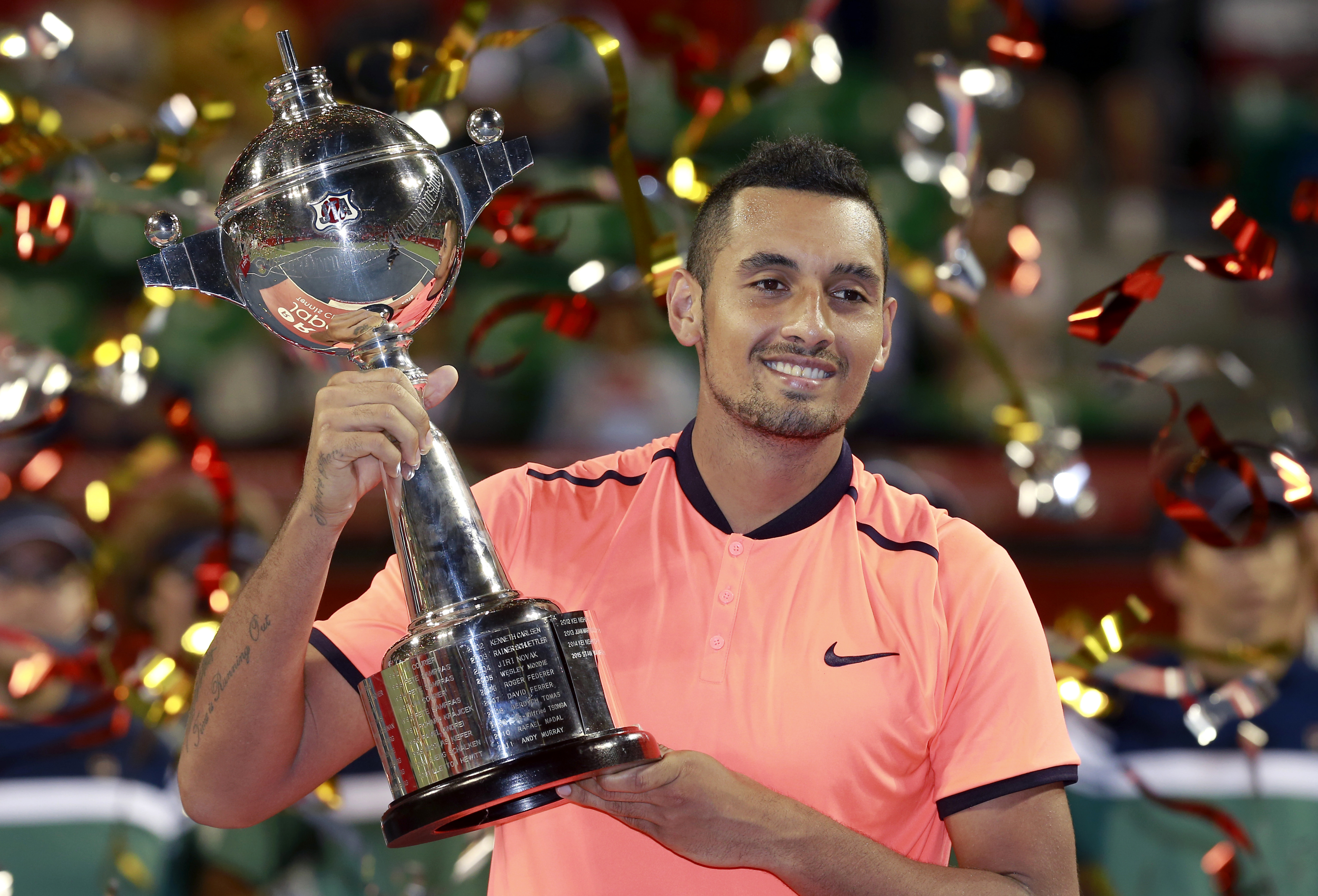 Nick Kyrgios of Australia poses after beating David Goffin of Belgium at the final match of Japan Open tennis tournament in Tokyo, Sunday, Oct. 9, 2016. (AP Photo/Shizuo Kambayashi)