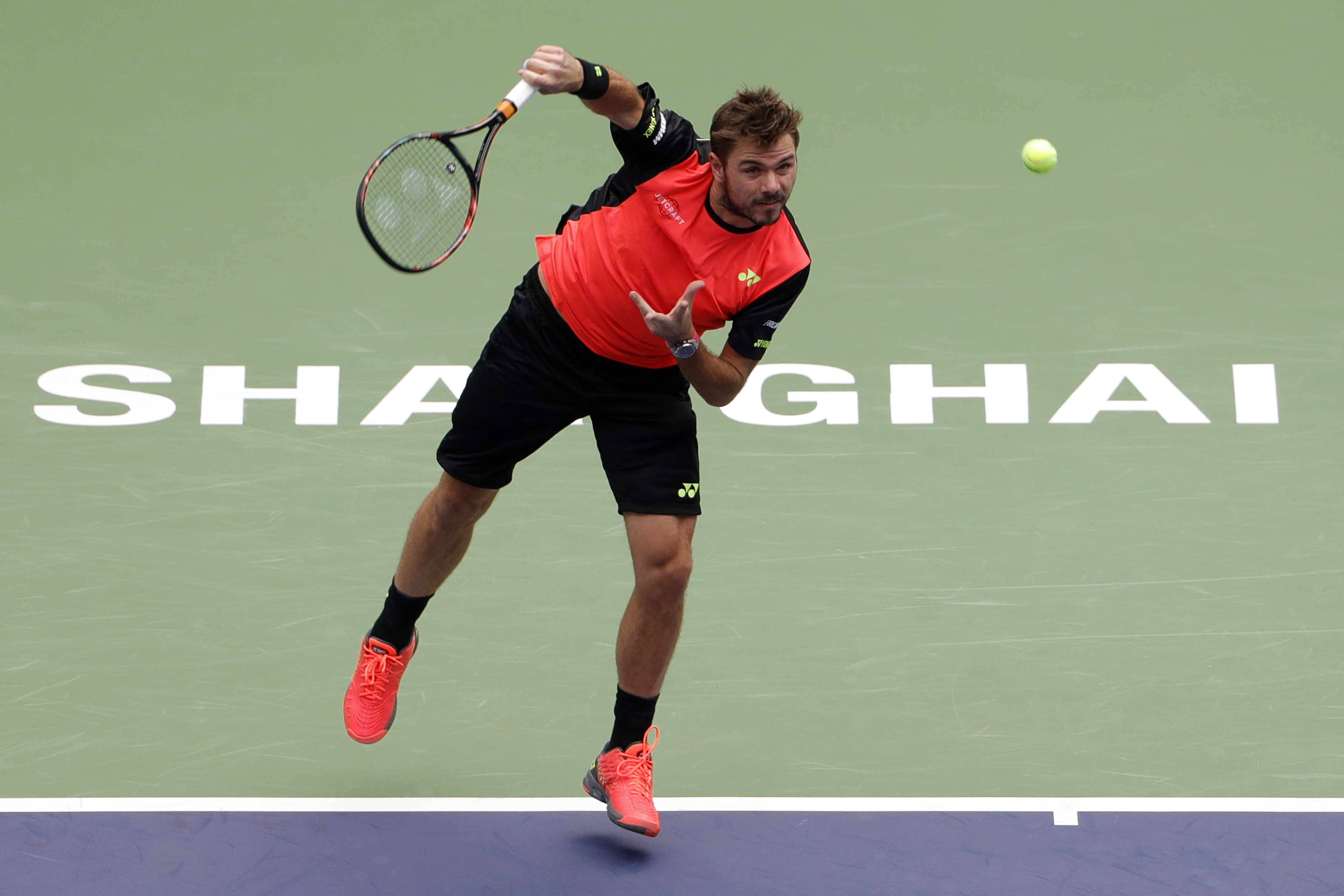 Stan Wawrinka of Switzerland serves against Kyle Edmund of Britain during the men's singles match of the Shanghai Masters tennis tournament at Qizhong Forest Sports City Tennis Center in Shanghai, China, Wednesday, Oct. 12, 2016. (AP Photo/Andy Wong)
