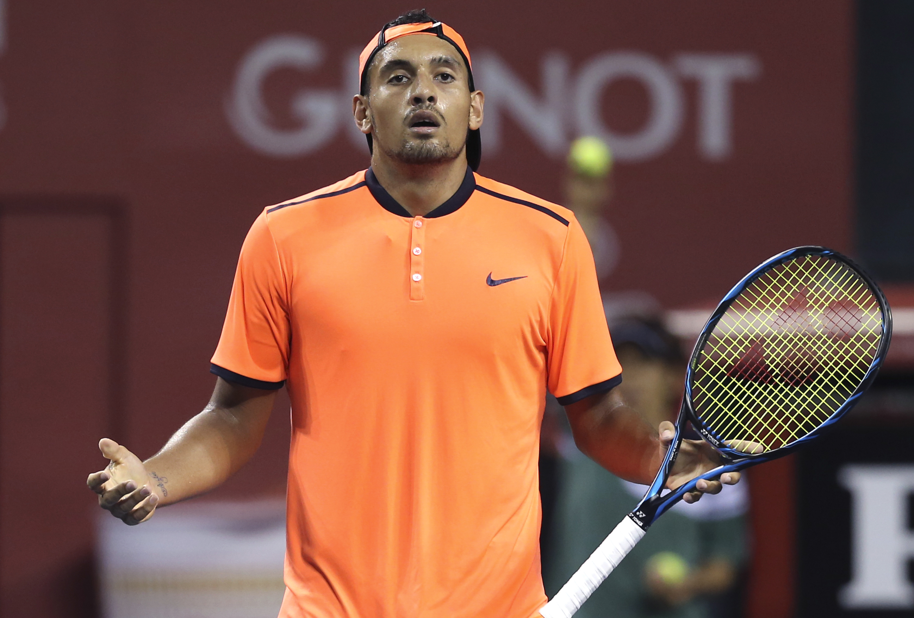FILE - In this Saturday, Oct. 8, 2016, file photo, Australia's Nick Kyrgios reacts after getting a point against Gael Monfils of France during the semifinal match of Japan Open tennis championships in Tokyo. Kyrgios was booed during a listless 6-3, 6-1 lo