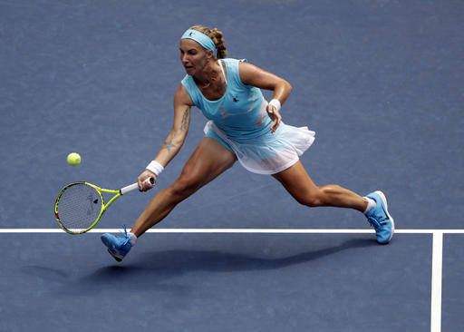 Svetlana Kuznetsova, of Russia, returns a shot to Caroline Wozniacki, of Denmark, during the second round of the U.S. Open tennis tournament, Wednesday, Aug. 31, 2016, in New York. (AP Photo/Seth Wenig)