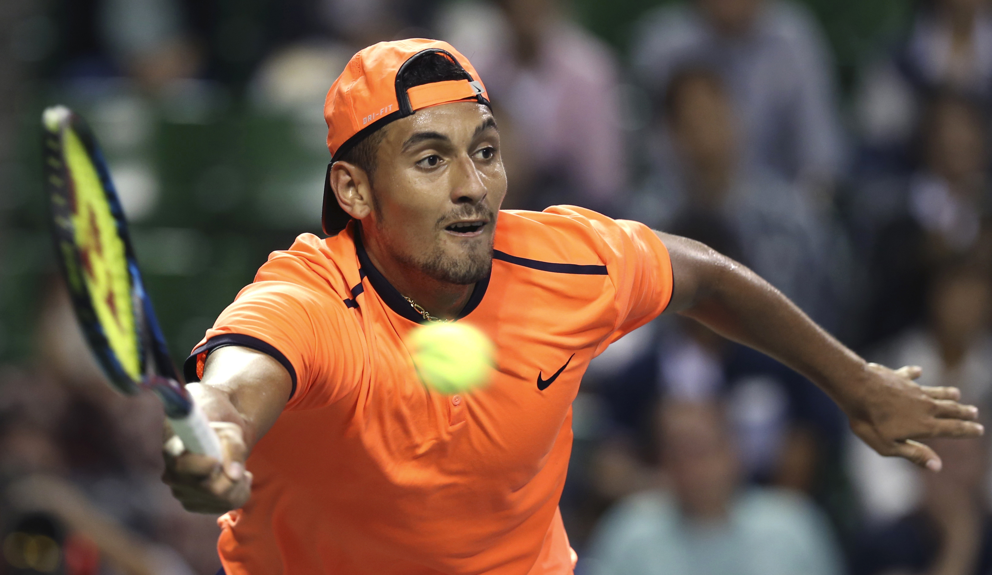 FILE - In this Saturday, Oct. 8, 2016, file photo, Australia's Nick Kyrgios returns a shot to Gael Monfils of France during the semifinal match of Japan Open tennis championships in Tokyo.  The ATP has suspended Nick Kyrgios for at least 3 weeks and fined
