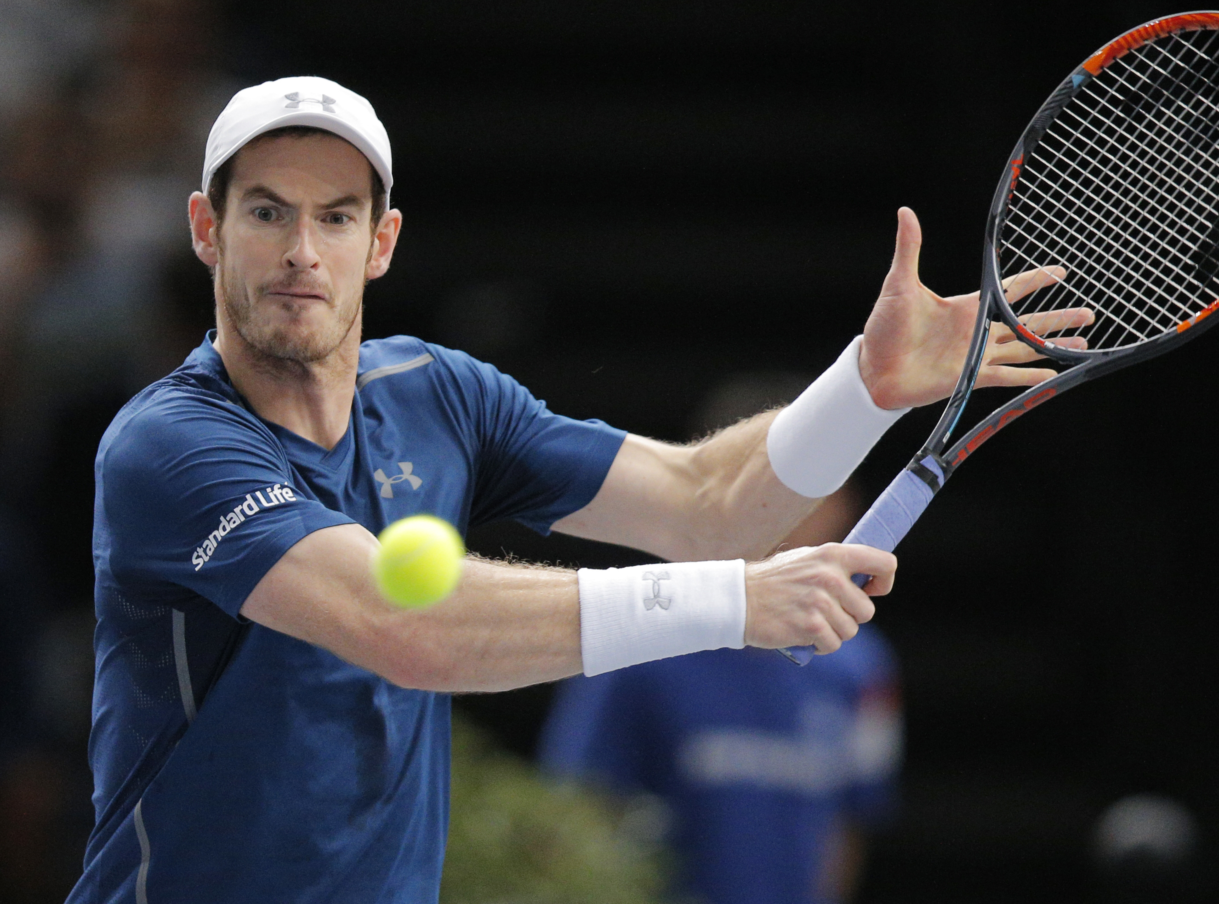 Andy Murray of Britain returns the ball to John Isner of the United States during the final of the Paris Masters tennis tournament at the Bercy Arena in Paris, Sunday, Nov. 6, 2016. (AP Photo/Michel Euler)