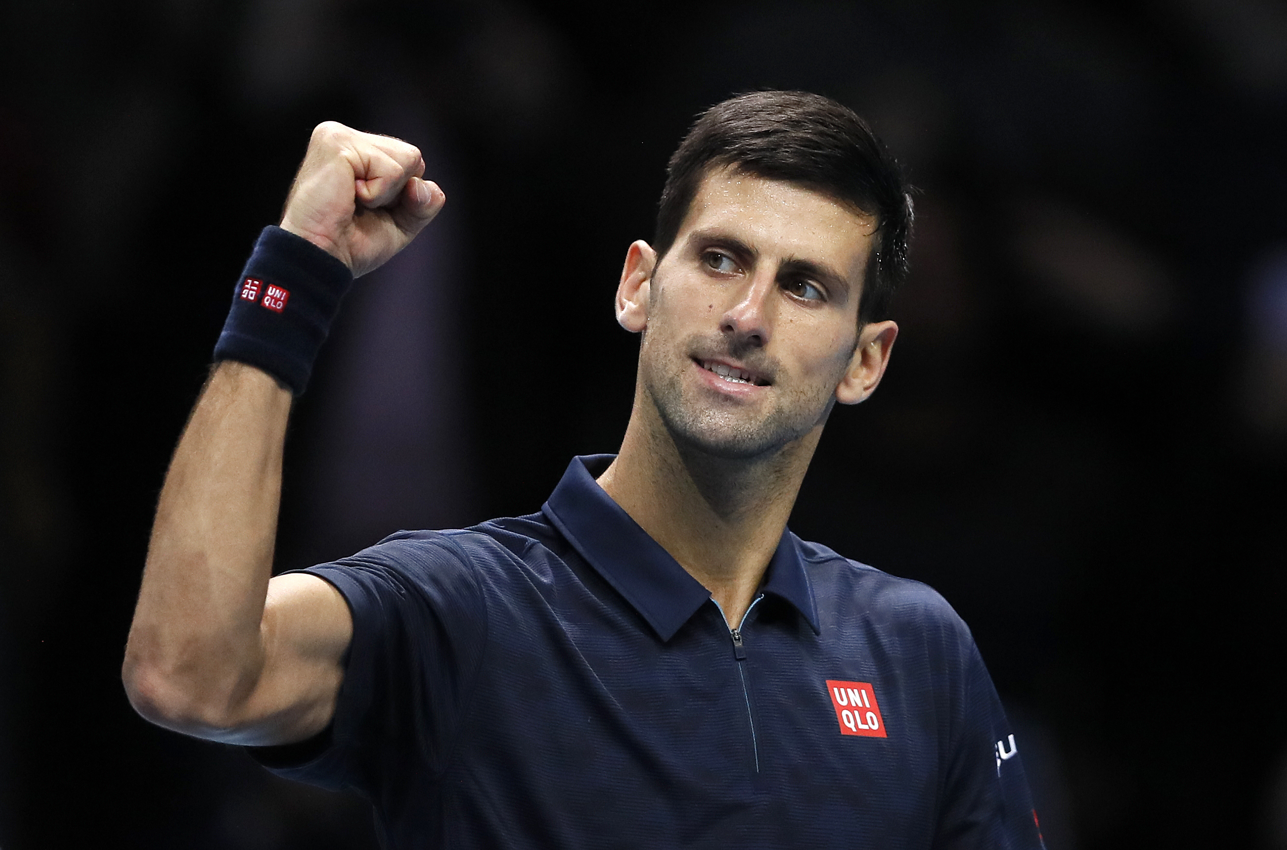 Novak Djokovic of Serbia celebrates winning match point against David Goffin of Belgium during their ATP World Tour Finals singles tennis match at the O2 Arena in London, Thursday, Nov. 17, 2016. (AP Photo/Kirsty Wigglesworth)