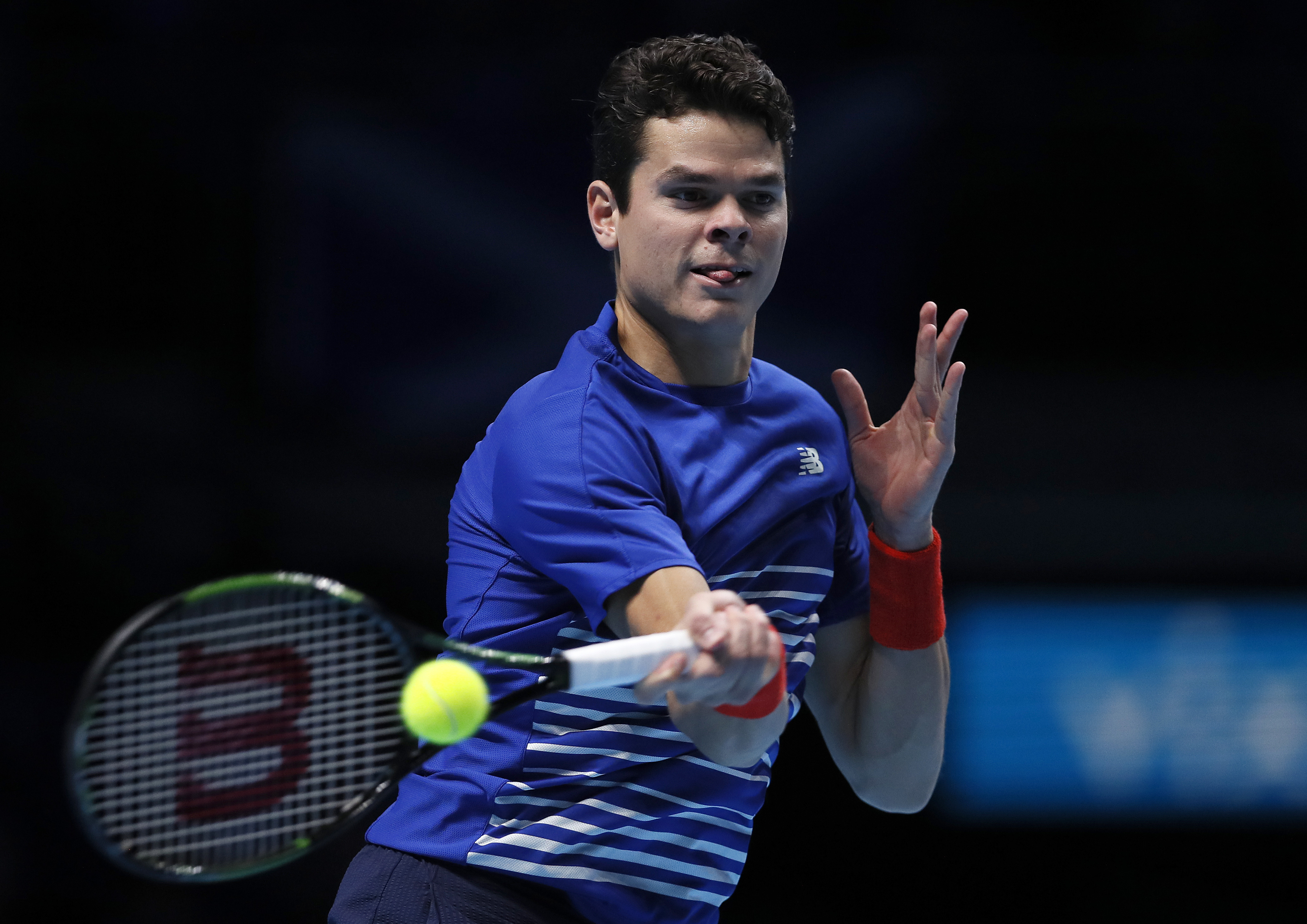 Milos Raonic of Canada plays a return to Andy Murray of Britain during their ATP World Tour Finals semifinal singles tennis match at the O2 Arena in London, Saturday, Nov. 19, 2016. (AP Photo/Kirsty Wigglesworth)