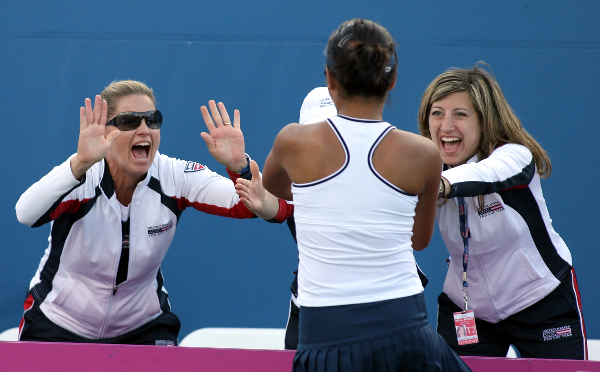 Vania King, center, of the United States, celebrates with team coach Kathy Rinaldi, left, an unidentified woman, center, and physical therapist Patricia Ladis, right, after defeating  Kirsten Flipkens, of Belgium, 4-6, 6-4, 7-5, at the 2007 Fed Cup quarte