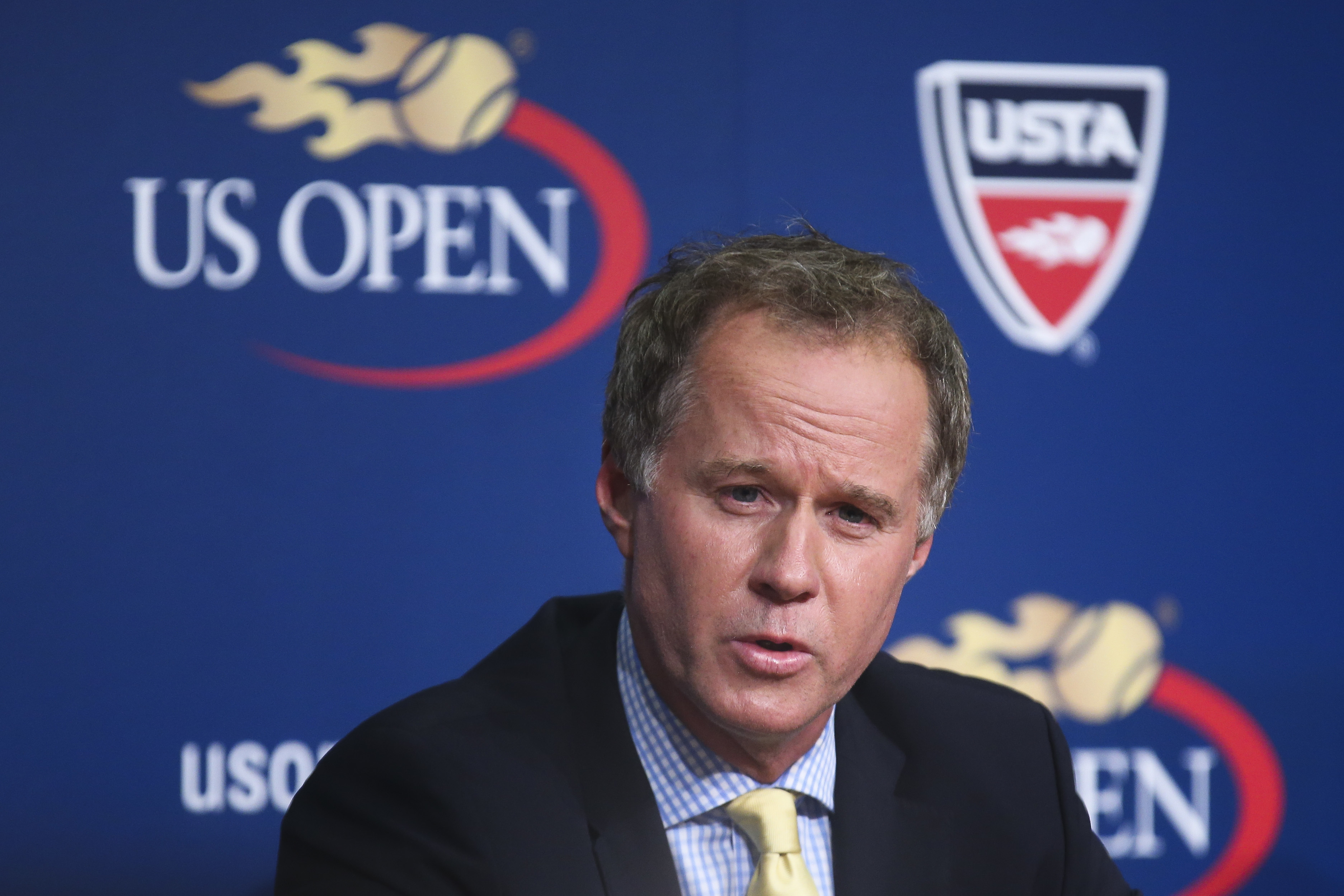 FILE - In this Sept. 3, 2014, file photo, Patrick McEnroe announces his resignation as the U.S. Tennis Association's general manager of player development, at a news conference at the U.S. Open tennis tournament in New York. Patrick McEnroe is the new co-