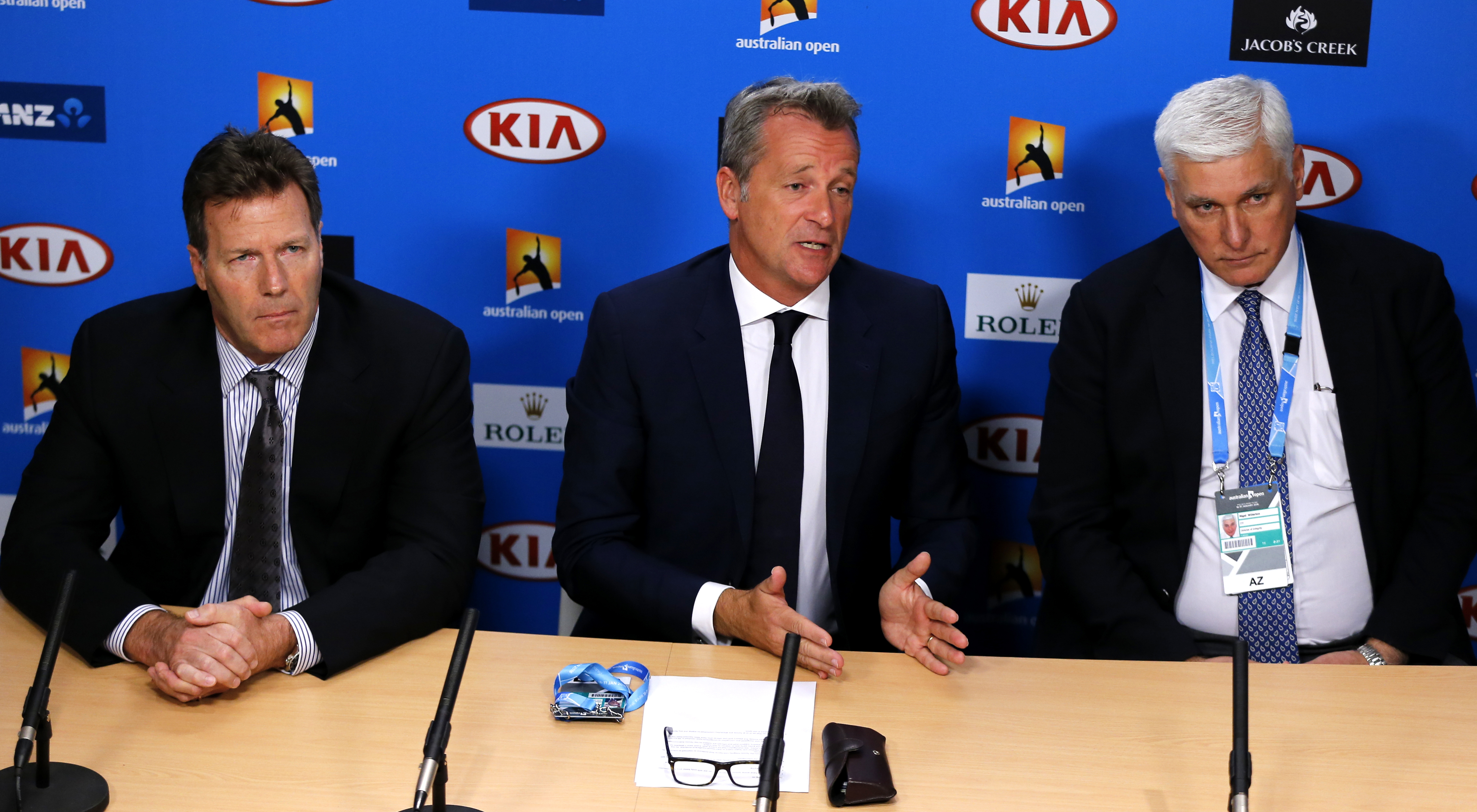 FILE - In this  Jan. 18, 2016 file photo, ATP chairman Chris Kermode, center, with Nigel Willerton, right, head of the Tennis Integrity Unit and ATP Vice Chairman Mark Young, speaks during a press conference at the Australian Open tennis championships in