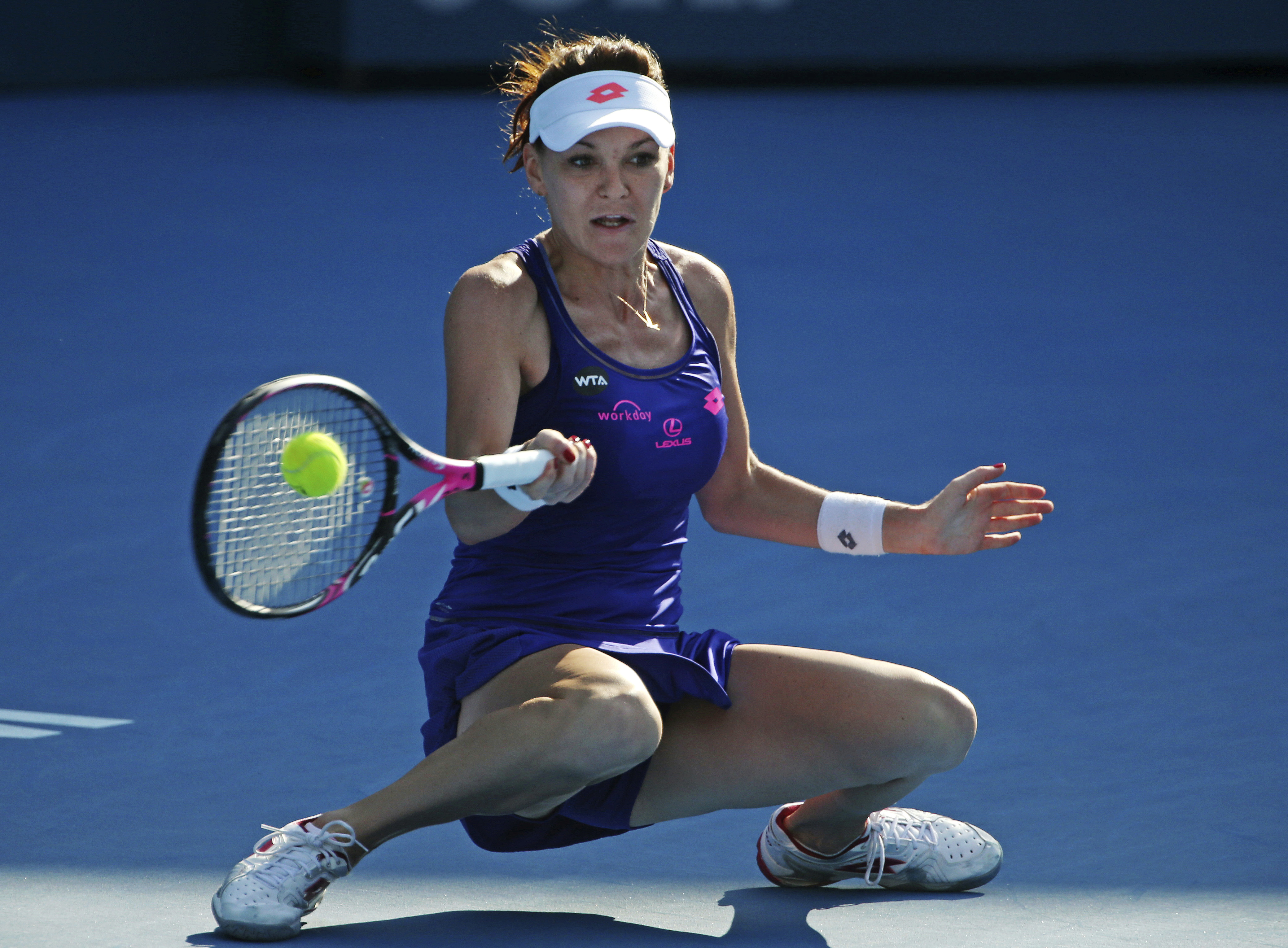 Agnieszka Radwanska of Poland plays a shot to Barbora Strycova of Czech Republic during their women's semifinal singles match at the Sydney International tennis tournament in Sydney Thursday, Jan. 12, 2017. (AP Photo/Rick Rycroft)