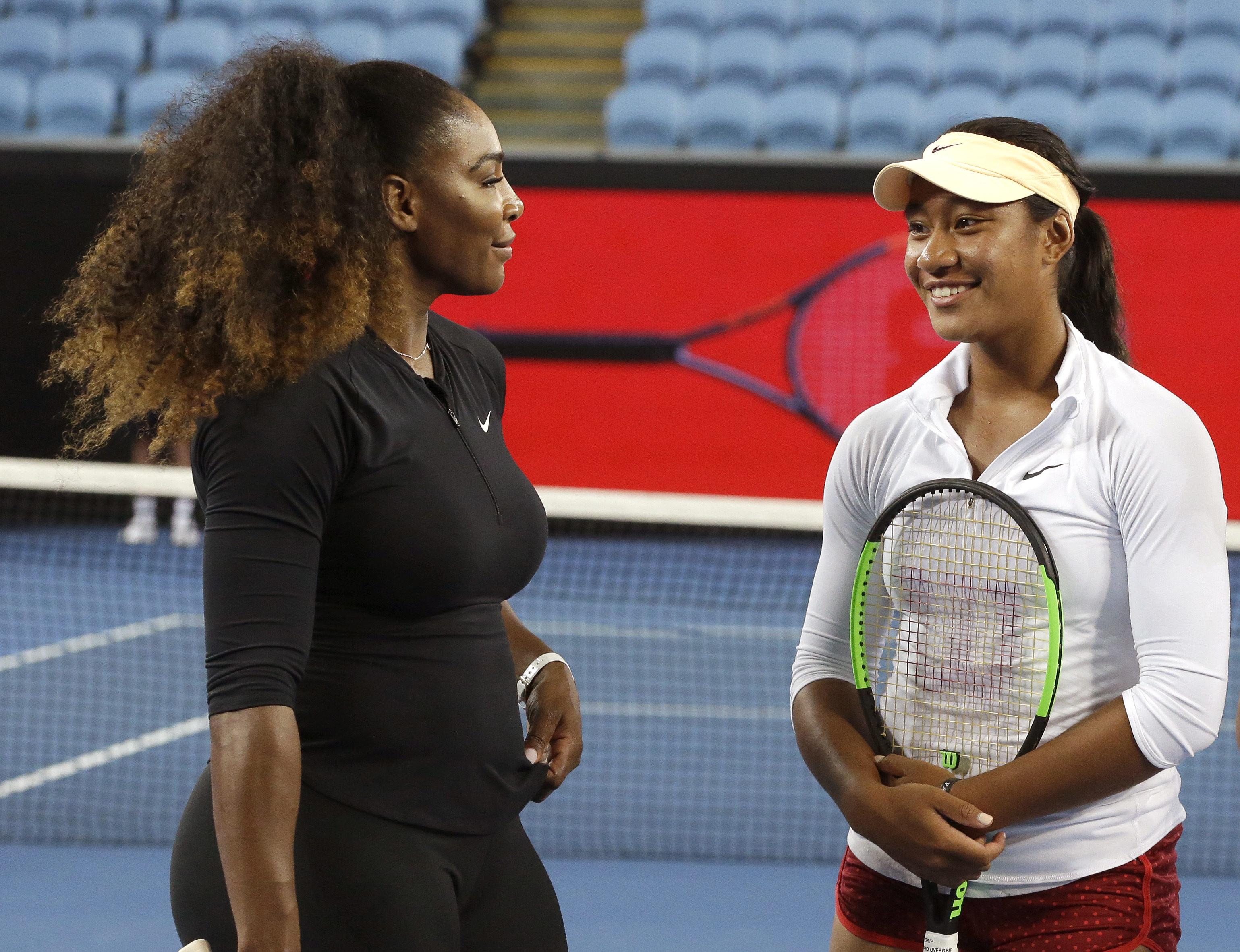 United States' Serena Williams, left, talks with Australian player Destanee Aiava during a promotional event on Margaret Court Arena ahead of the Australian Open tennis championships in Melbourne, Australia, Thursday, Jan. 12, 2017. Aiava will be the firs