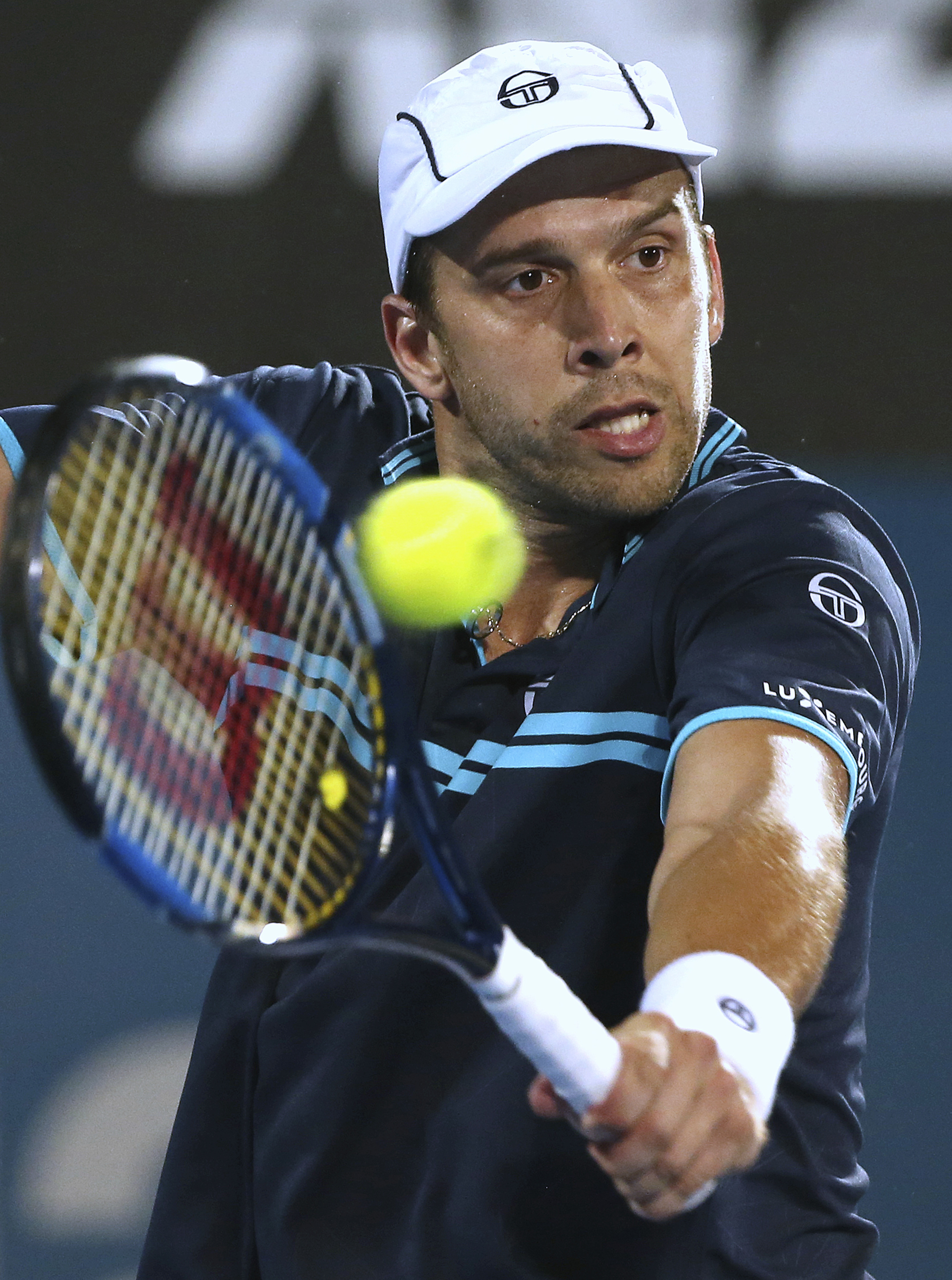 Gilles Muller of Luxembourg plays a shot to Britain's Daniel Evans during the men's singles final at the Sydney International tennis tournament in Sydney, Australia, Saturday, Jan. 14, 2017. (AP Photo/Rick Rycroft)