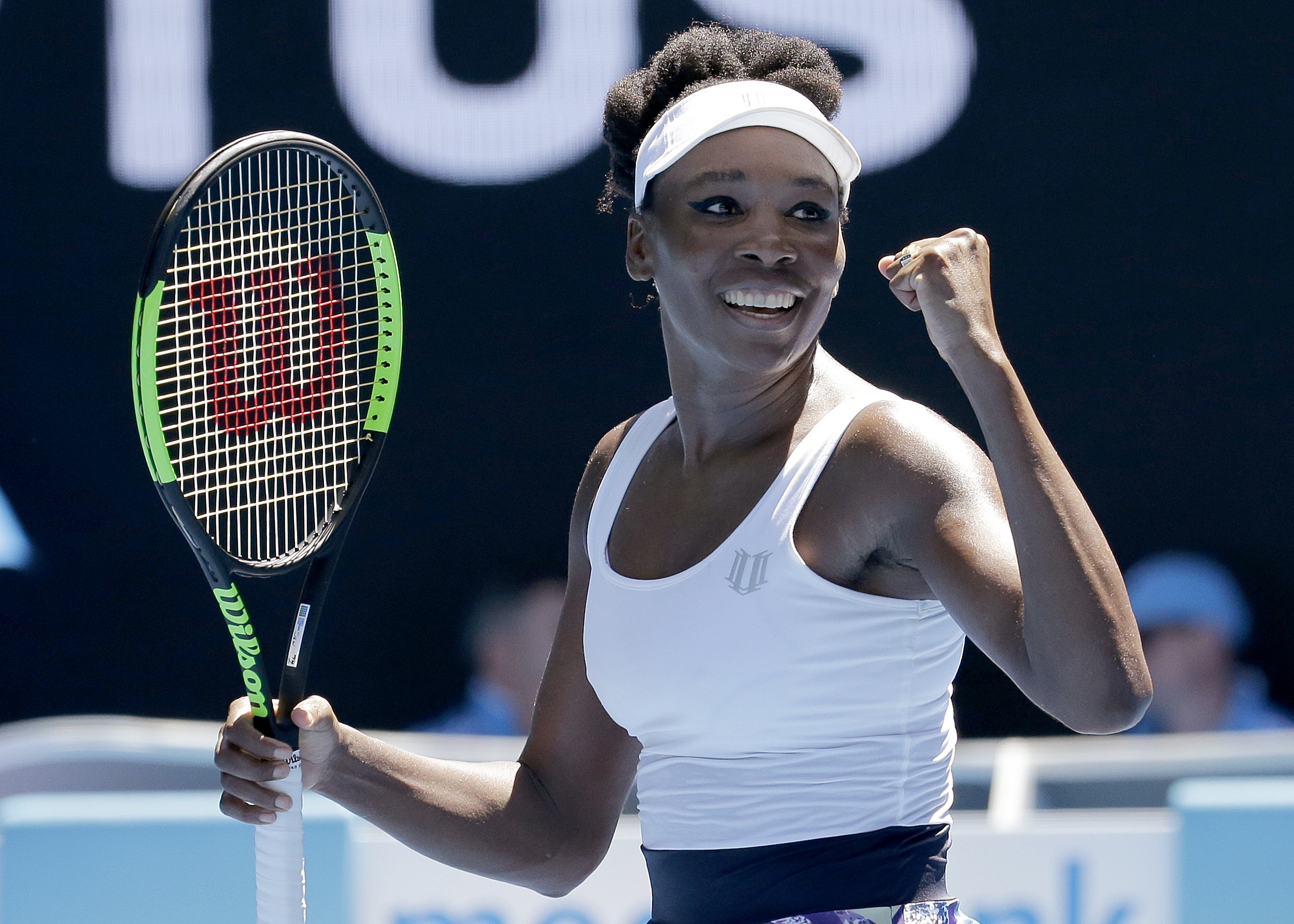 United States' Venus Williams celebrates after defeating Ukraine's Kateryna Kozlova in their first round match the Australian Open tennis championships in Melbourne, Australia, Monday, Jan. 16, 2017. (AP Photo/Aaron Favila)