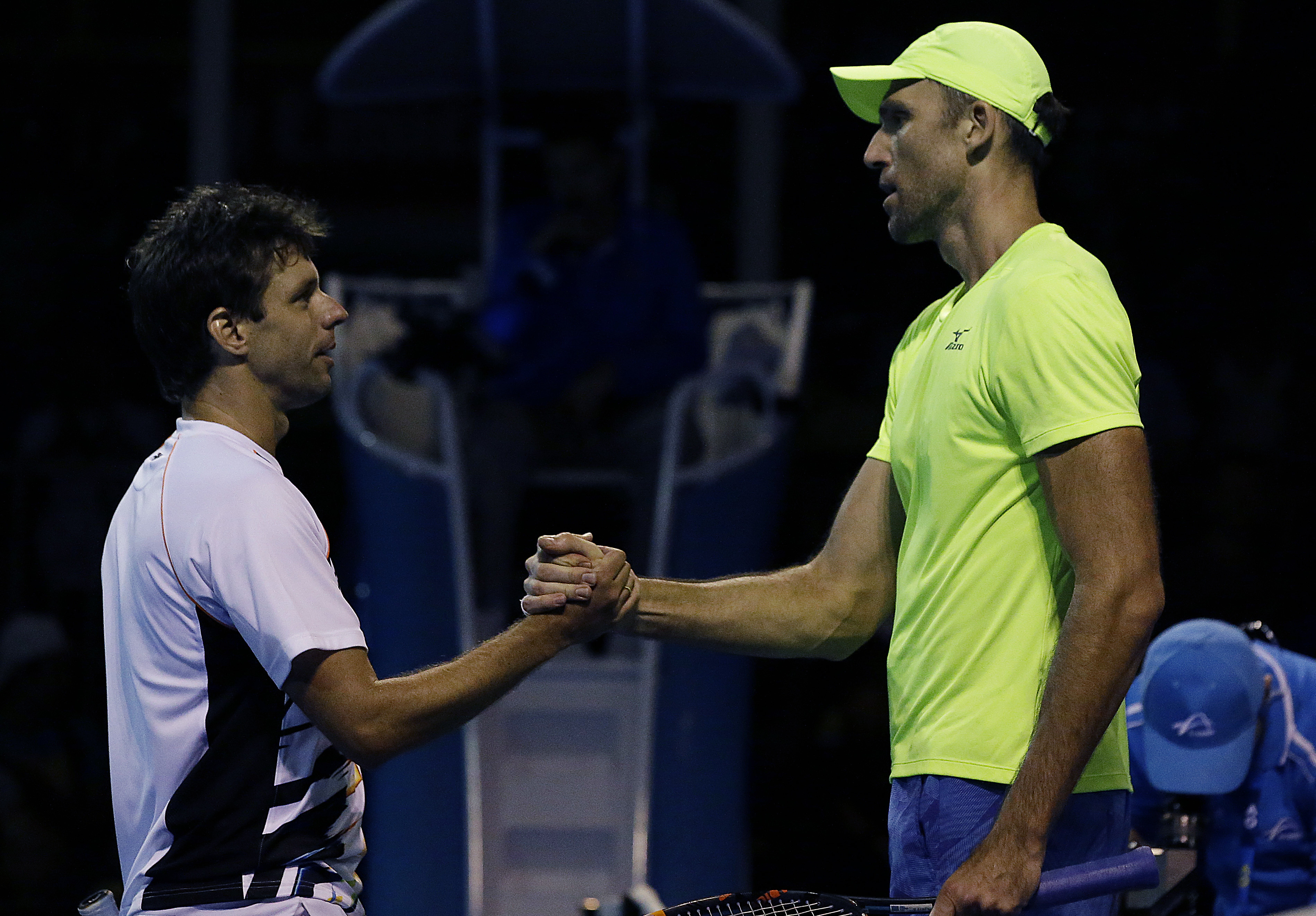 Croatia's Ivo Karlovic, right, is congratulated by Argentina's Horacio Zeballos after winning their first round match at the Australian Open tennis championships in Melbourne, Australia, Tuesday, Jan. 17, 2017. (AP Photo/Aaron Favila)