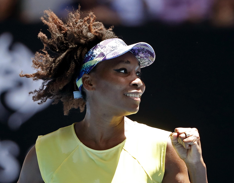 United States' Venus Williams celebrates her win over Switzerland's Stefanie Voegele during their second round match at the Australian Open tennis championships in Melbourne, Australia, Wednesday, Jan. 18, 2017. (AP Photo/Dita Alangkara)