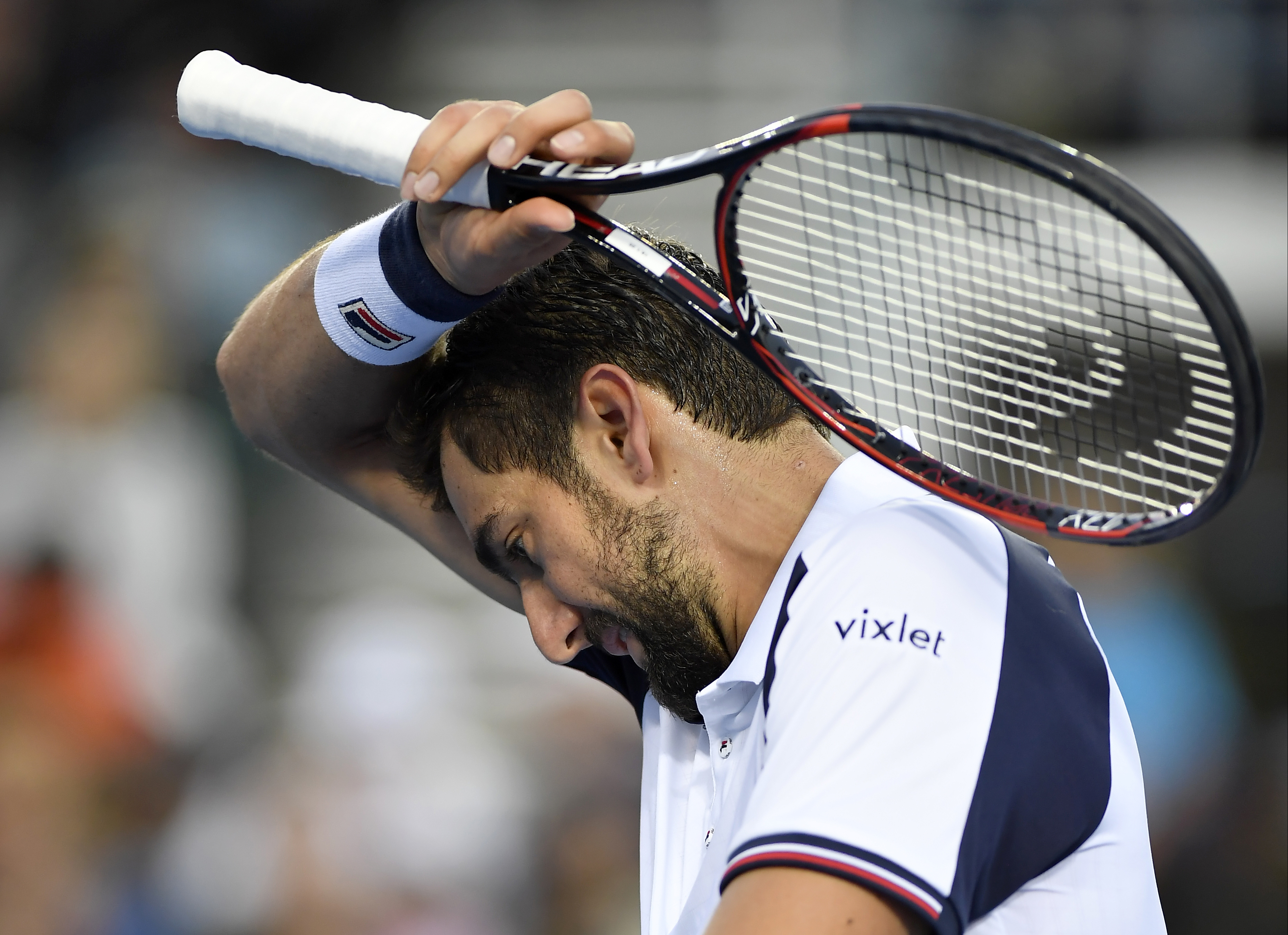 Croatia's Marin Cilic wipes the sweat from his face during his second round match against Britain's Daniel Evans at the Australian Open tennis championships in Melbourne, Australia, Wednesday, Jan. 18, 2017. (AP Photo/Andy Brownbill)