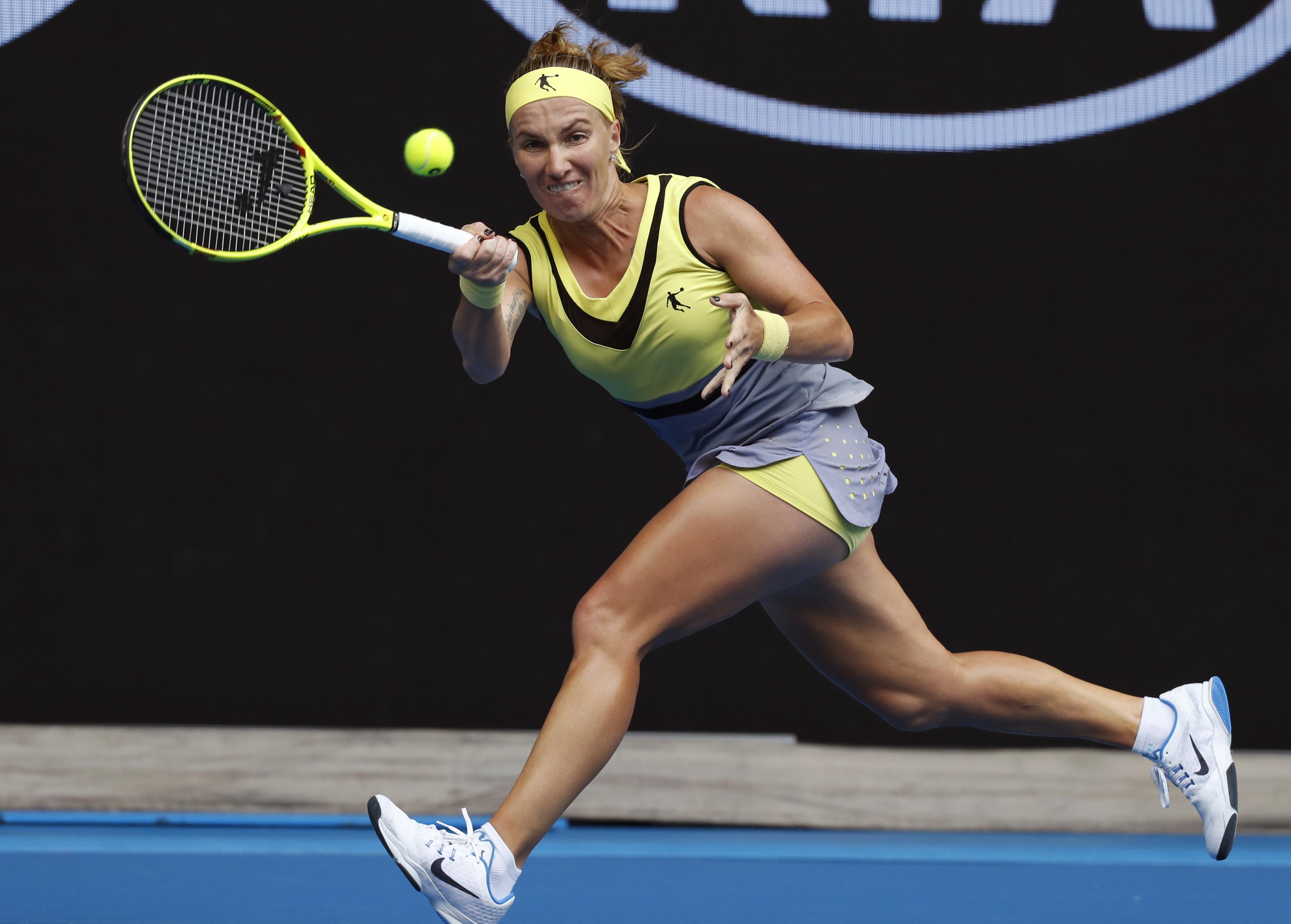 Russia's Svetlana Kuznetsova makes a forehand return to Serbia's Jelena Jankovic during their third round match at the Australian Open tennis championships in Melbourne, Australia, Friday, Jan. 20, 2017. (AP Photo/Kin Cheung)