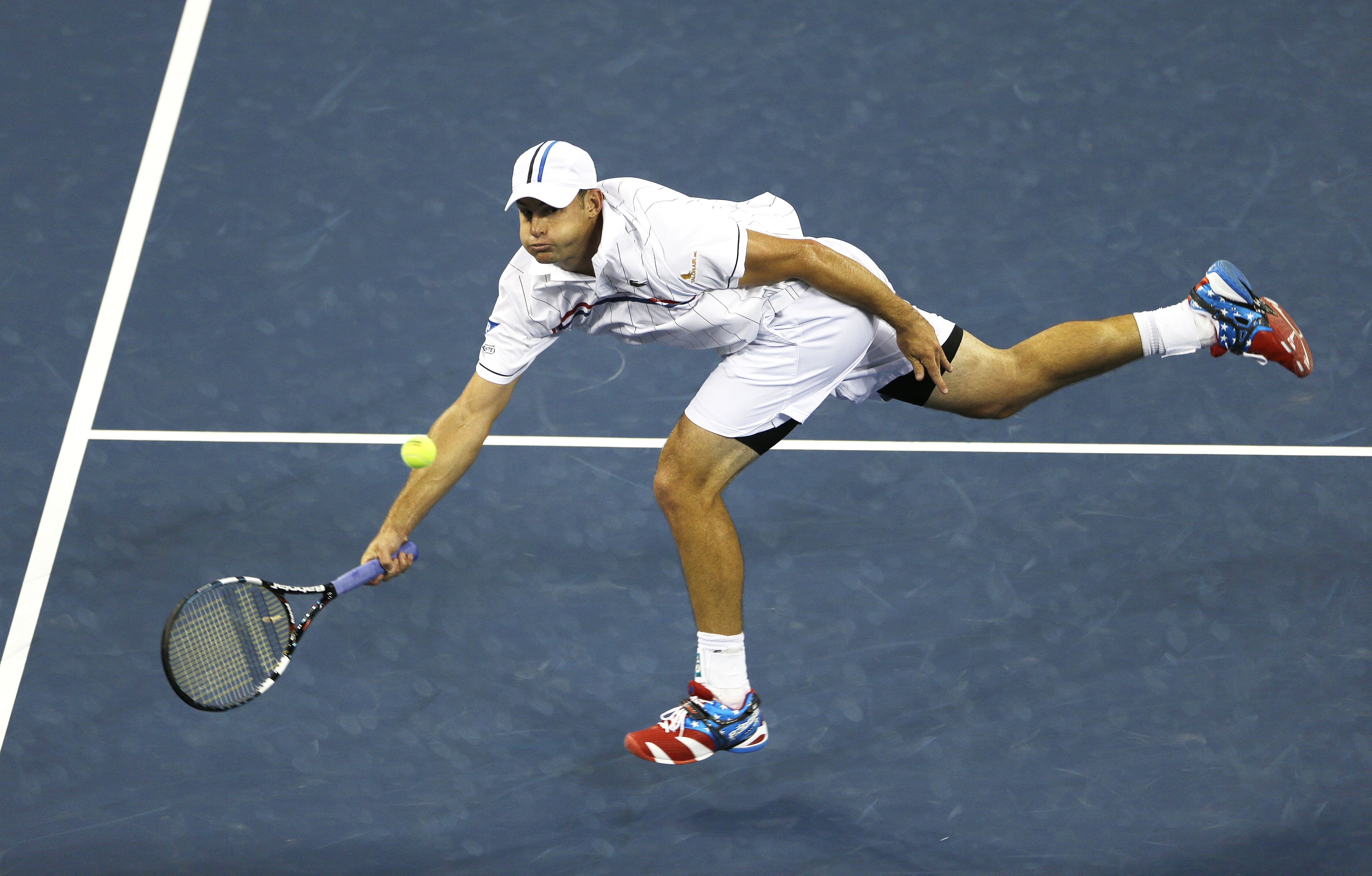 FILE - In this Aug. 31, 2012, file photo, Andy Roddick returns a shot to Australia's Bernard Tomic in the third round of play at the 2012 US Open tennis tournament in New York. Roddick and Kim Clijsters have been elected to the International Tennis Hall o