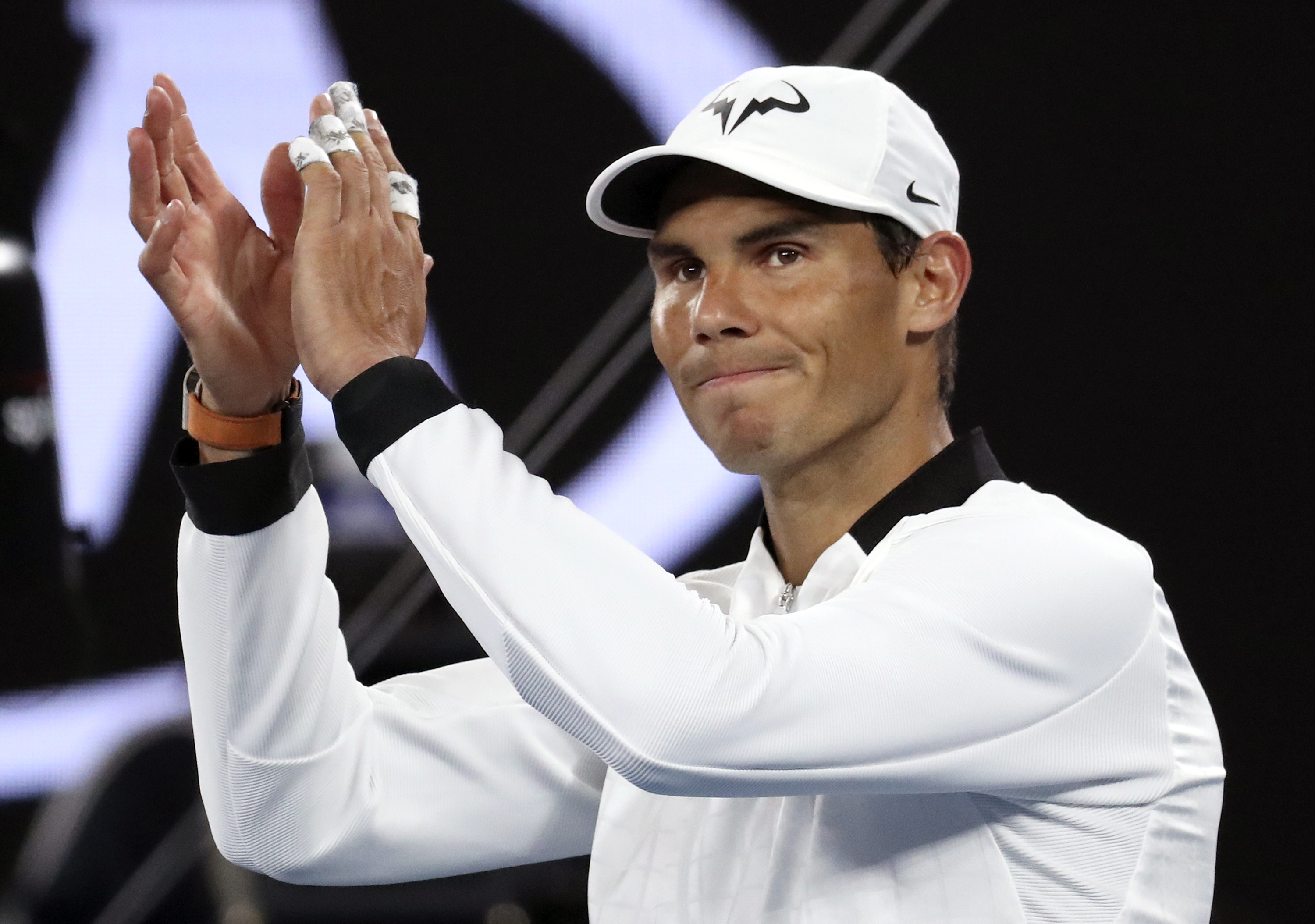 Spain's Rafael Nadal celebrates after defeating Canada's Milos Raonic during their quarterfinal at the Australian Open tennis championships in Melbourne, Australia, Wednesday, Jan. 25, 2017. (AP Photo/Aaron Favila)