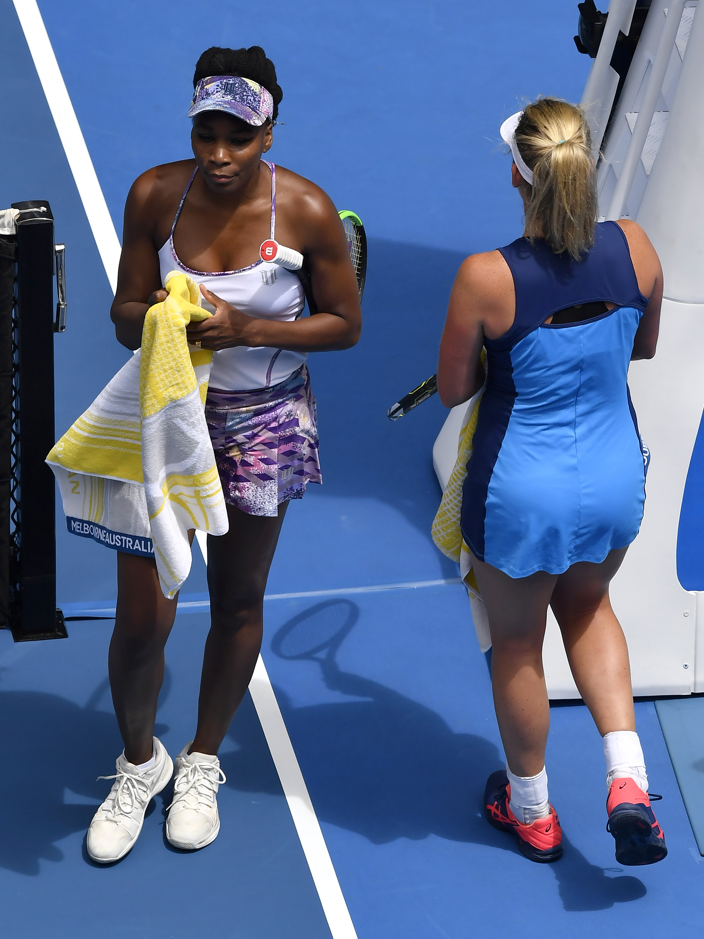 United States' Venus Williams, left, walks past compatriot Coco Vandeweghe during their semifinal at the Australian Open tennis championships in Melbourne, Australia, Thursday, Jan. 26, 2017. (AP Photo/Andy Brownbill)