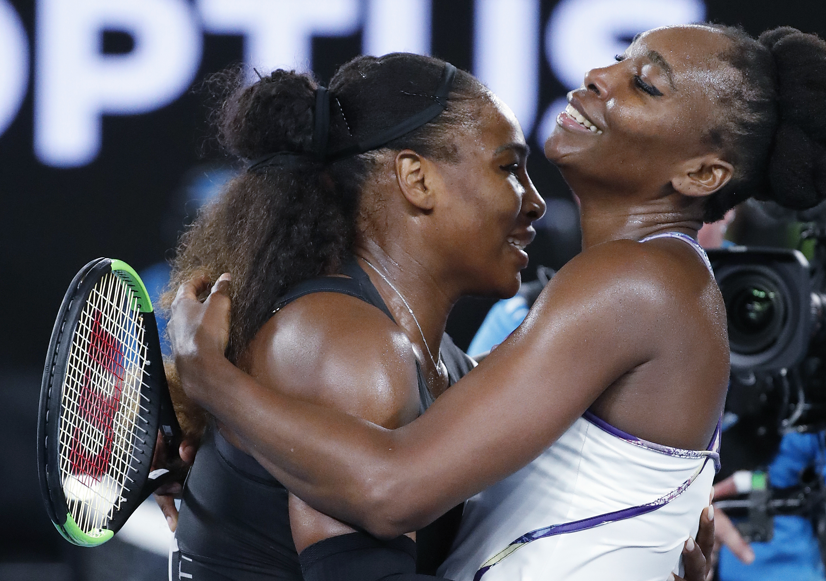 In this Saturday, Jan. 28, 2017 photo, United States' Serena Williams, left, embraces her sister, Venus, as she celebrates after winning the women's singles final at the Australian Open tennis championships in Melbourne, Australia. (AP Photo/Dita Alangkar