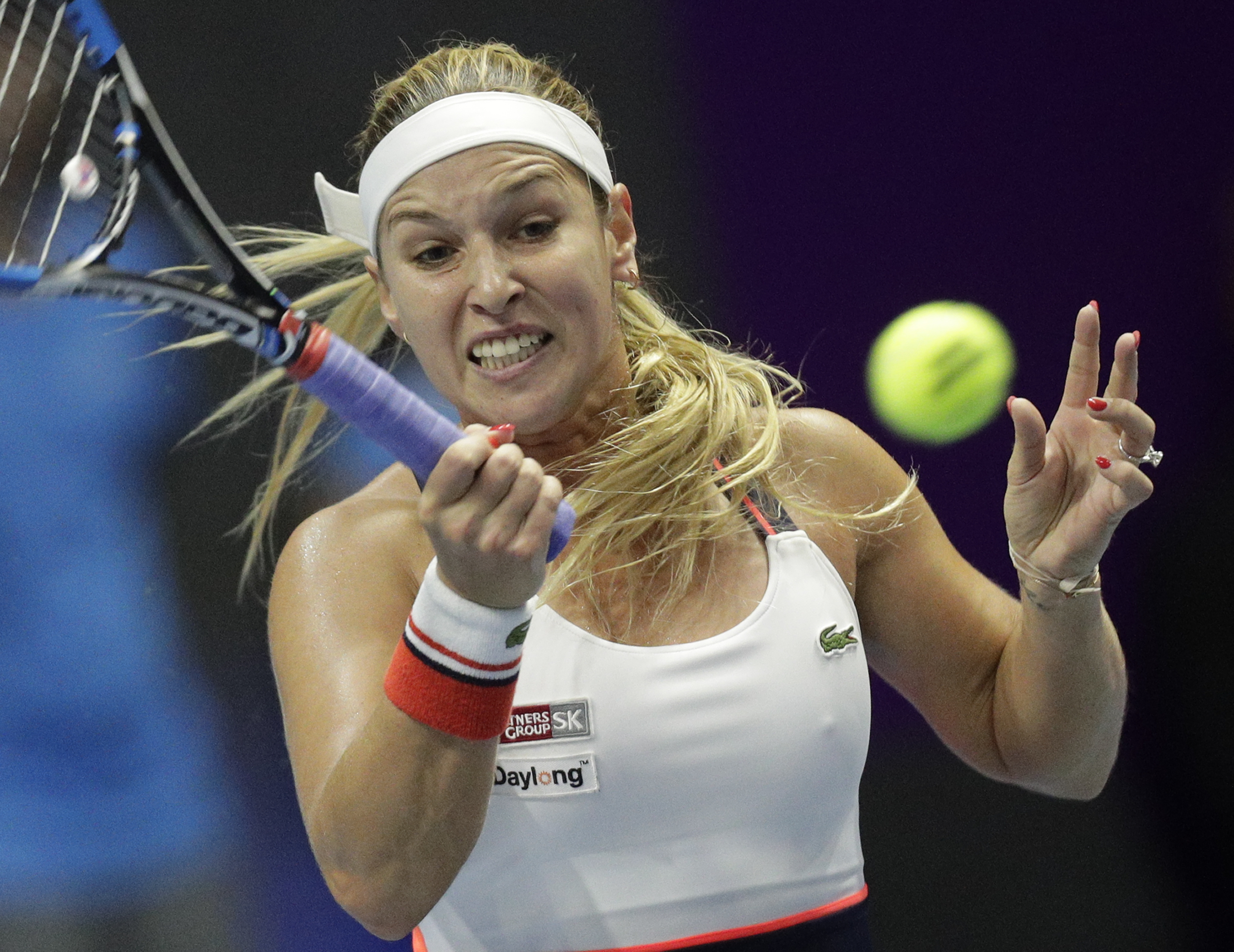 Dominika Cibulkova of Slovakia returns the ball to Elena Vesnina of Russia during the St. Petersburg Ladies Trophy-2017 tennis tournament quarterfinal match in St.Petersburg, Russia, Friday, Feb. 3, 2017. (AP Photo/Dmitri Lovetsky)
