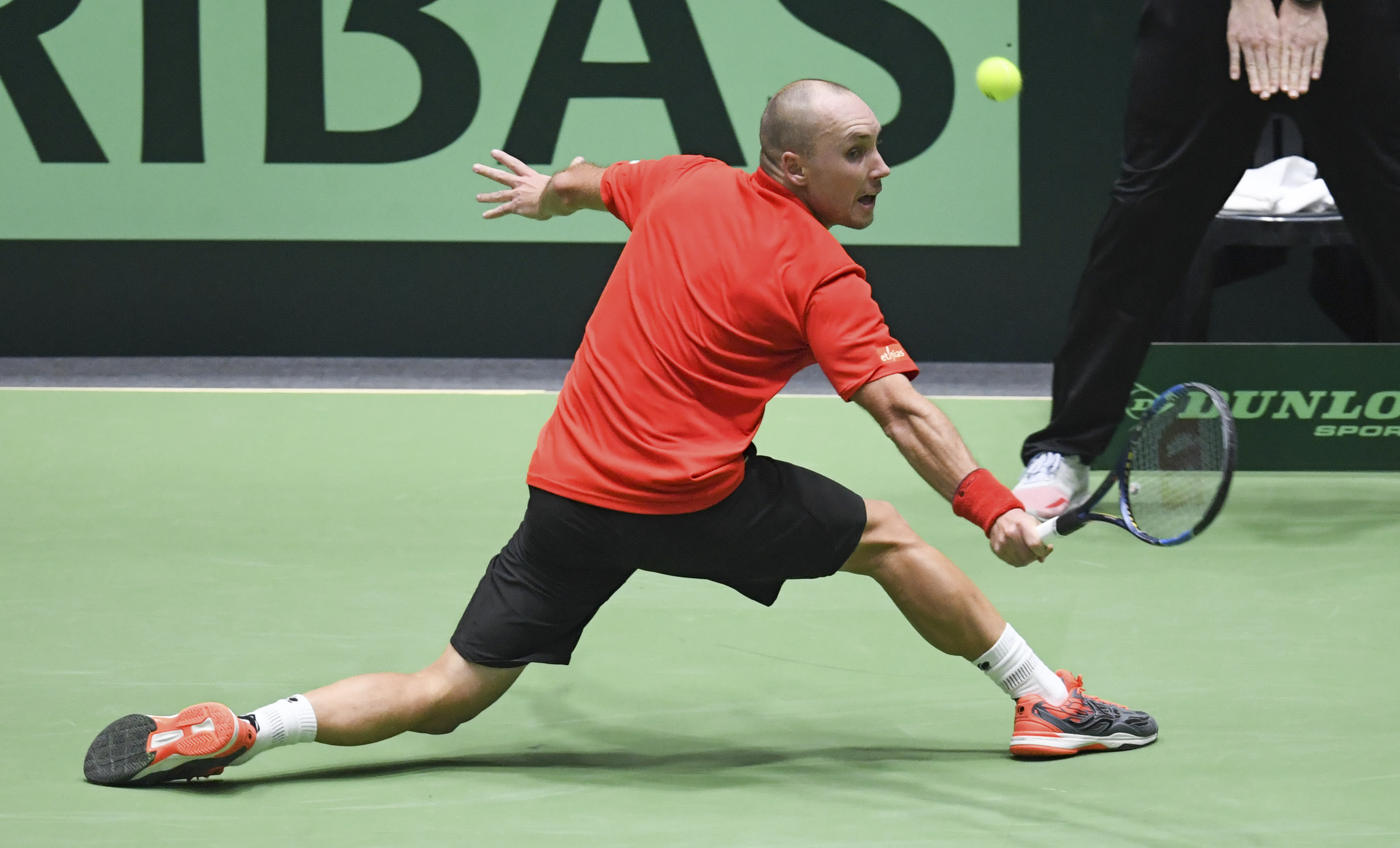 Belgium's Steve Darcis returns a shot to Germany's Philipp Kohlschreiber during a single match of the Davis Cup World Group 1, first round tennis match between Germany and Belgium,  in Frankfurt, Germany, Friday, Feb. 3, 2017.   (Arne Dedert/dpa via AP)