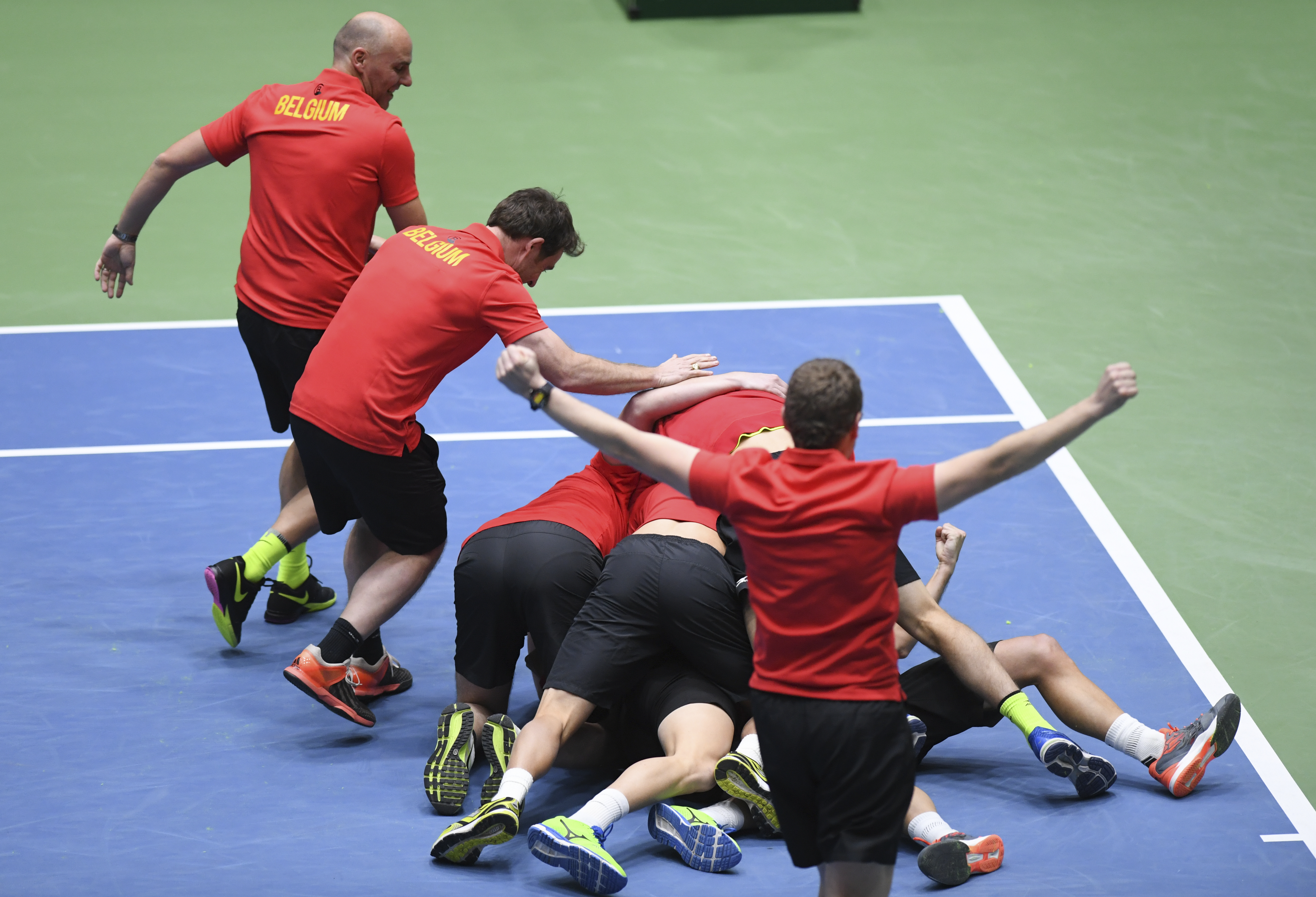 Belgian tennis players and team members celebrate after Steve Darcis won his match against Germany's Alexander Zverev in the first round Davis Cup tennis match, giving Belgium a decisive  3-1 lead , in Frankfurt, Germany, Sunday Feb. 5, 2017.  (Arne Deder