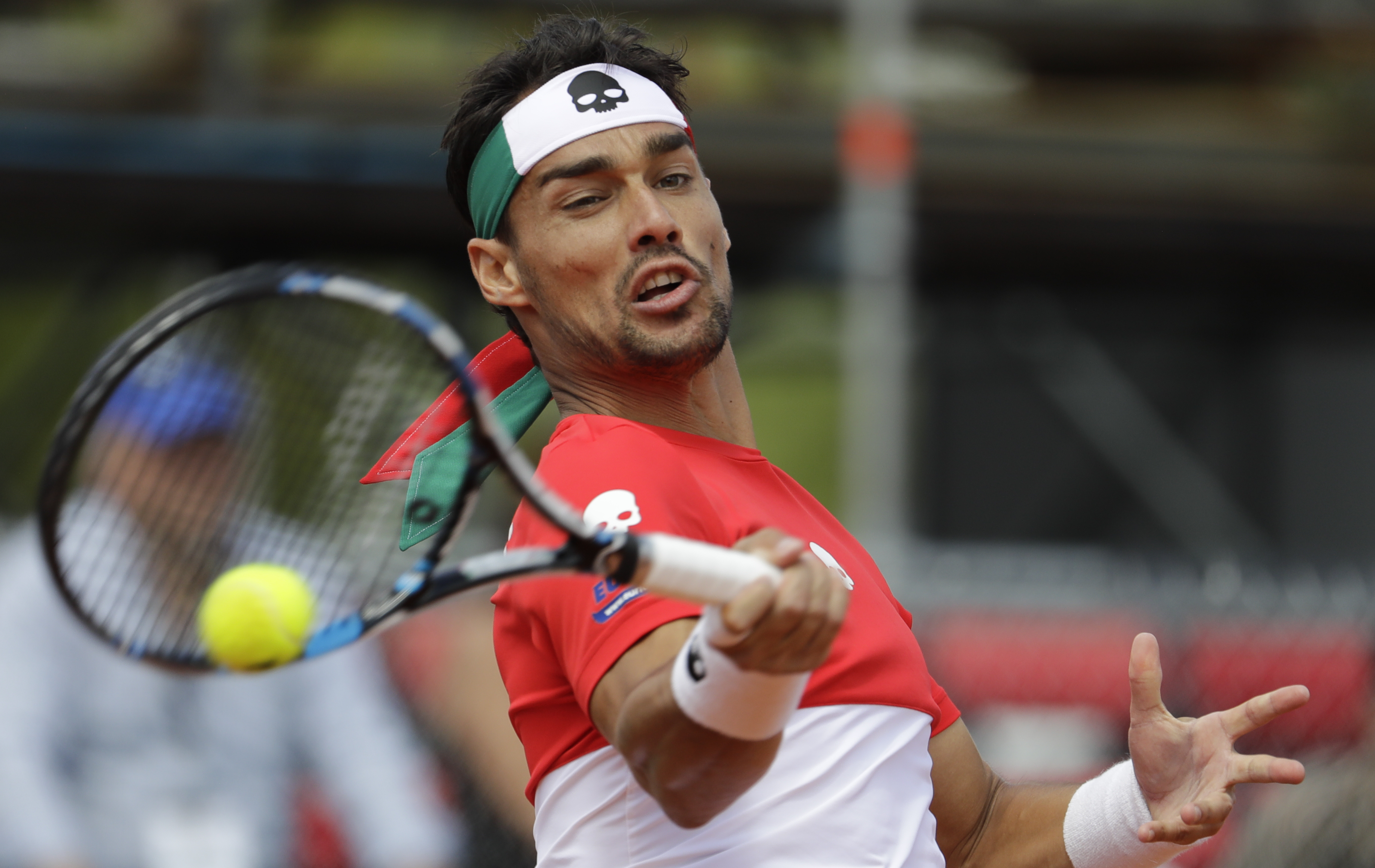 Italy's Fabio Fognini returns the ball to Argentina's Guido Pella during the Davis Cup first round tennis match in Buenos Aires, Argentina, Monday, Feb. 6, 2017.(AP Photo/Natacha Pisarenko)