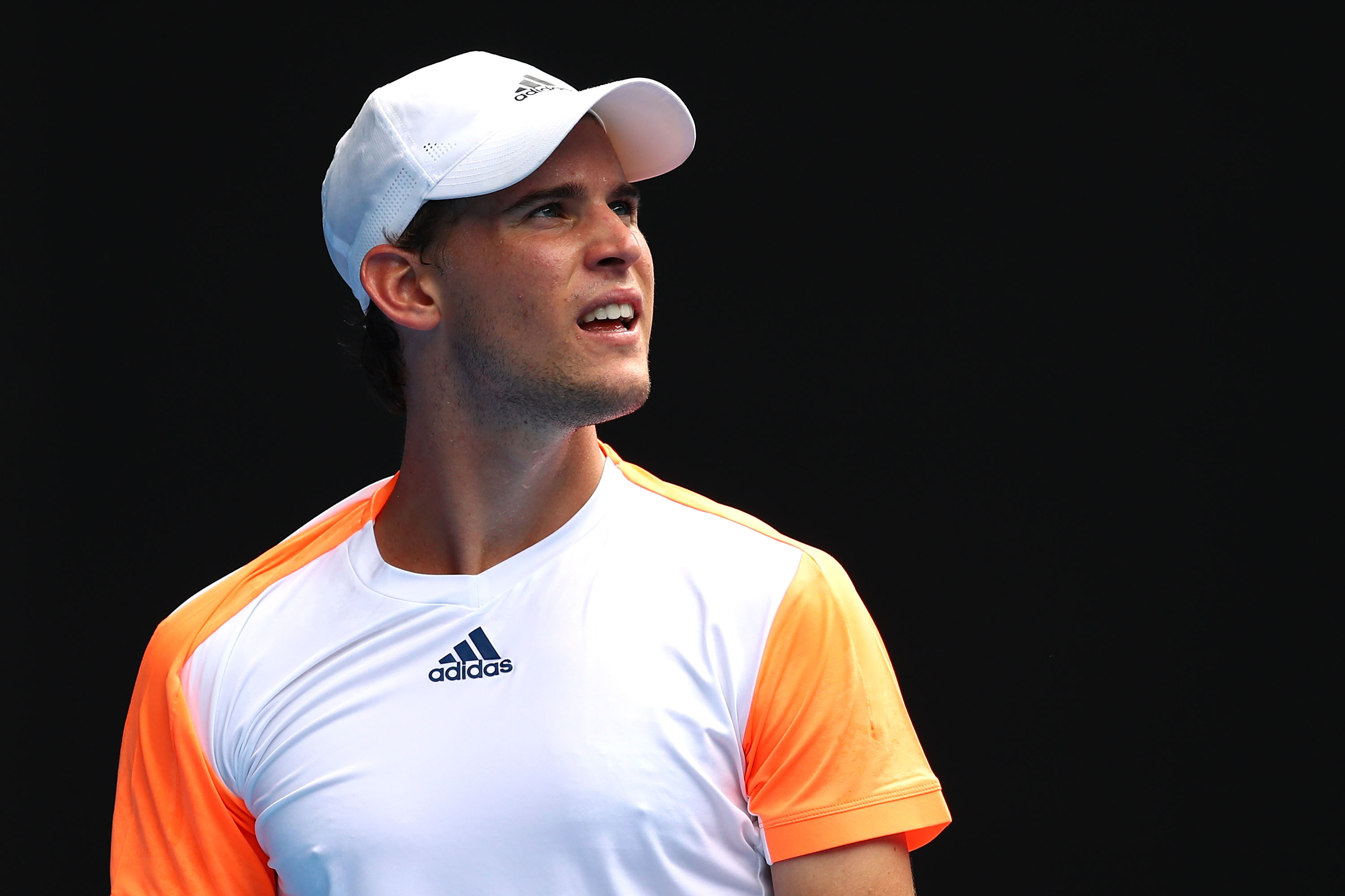 MELBOURNE, AUSTRALIA - JANUARY 23:  Dominic Thiem of Austria looks on in his fourth round match against David Goffin of Belgium on day eight of the 2017 Australian Open at Melbourne Park on January 23, 2017 in Melbourne, Australia.  (Photo by Cameron Spen