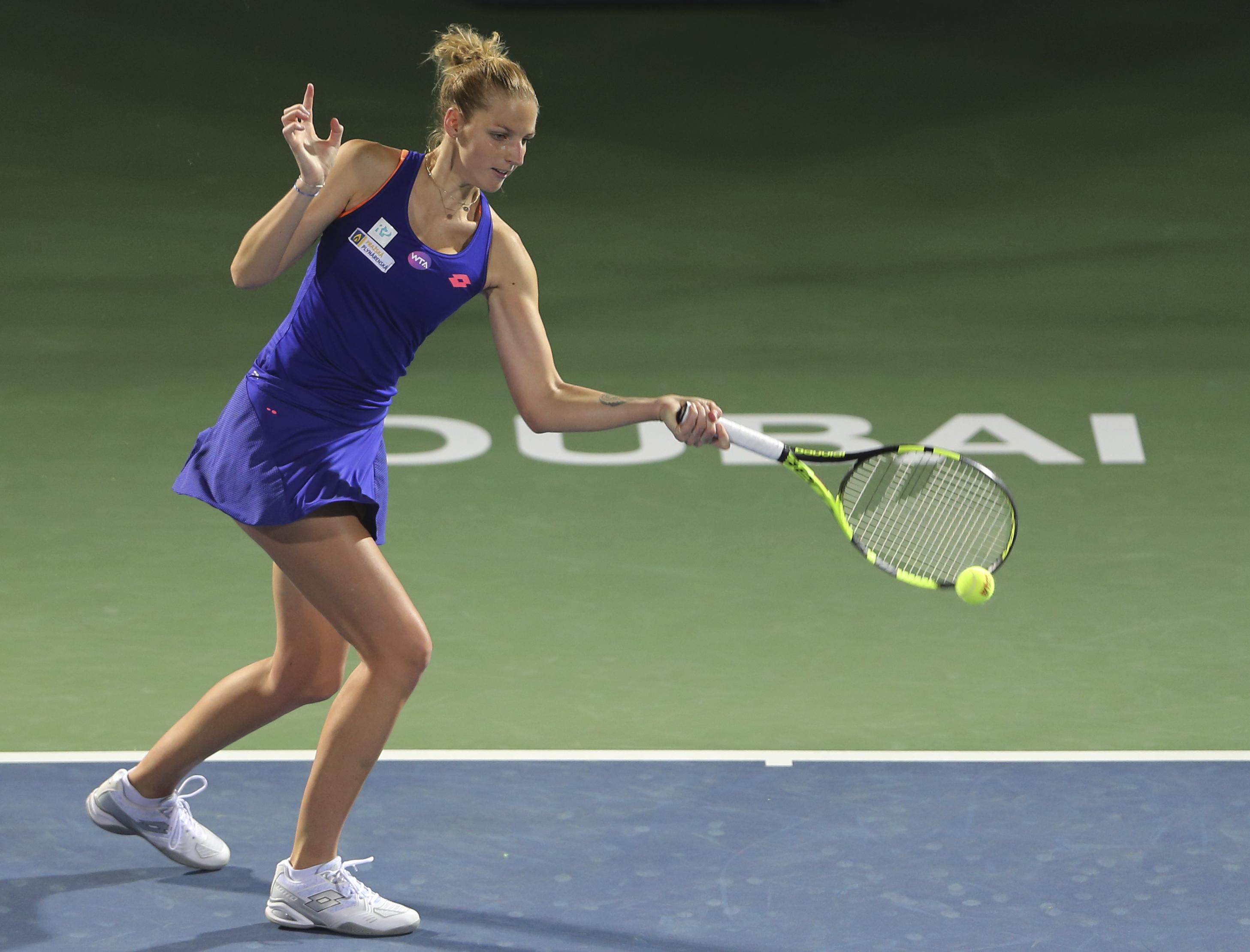 Kristyna Pliskova of Czech Republic returns the ball to Roberta Vinci of Italy during the Dubai Tennis Championships, in Dubai, United Arab Emirates, Sunday, Feb. 19, 2017. (AP Photo/Kamran Jebreili)
