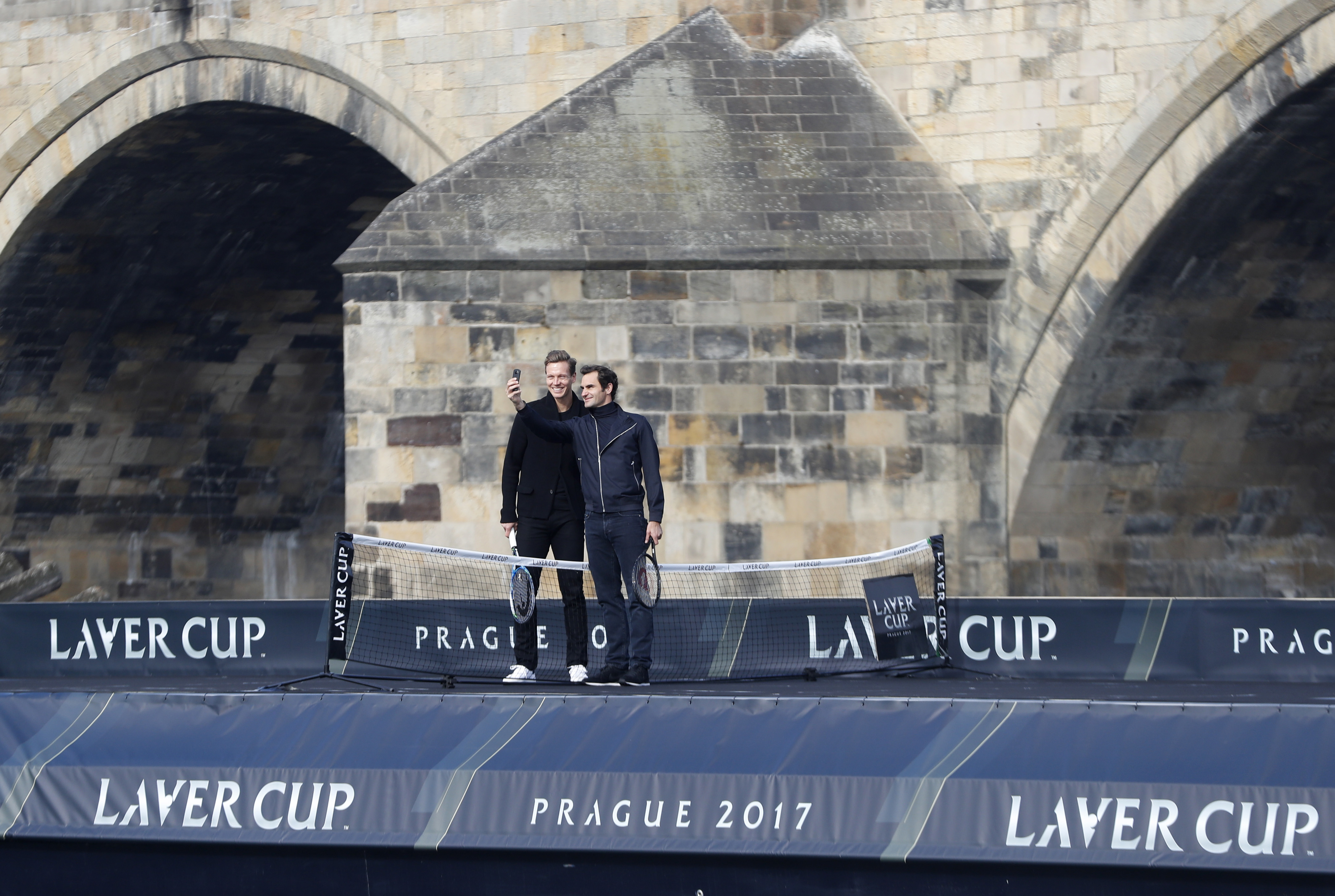 Switzerland's tennis player Roger Federer, right, and Czech Republic's Tomas Berdych, left, pose for a photo during a exhibition match on Vltava river in Prague, Czech Republic, Monday, Feb. 20, 2017. Federer arrived in Prague to promote the Laver Cup, a