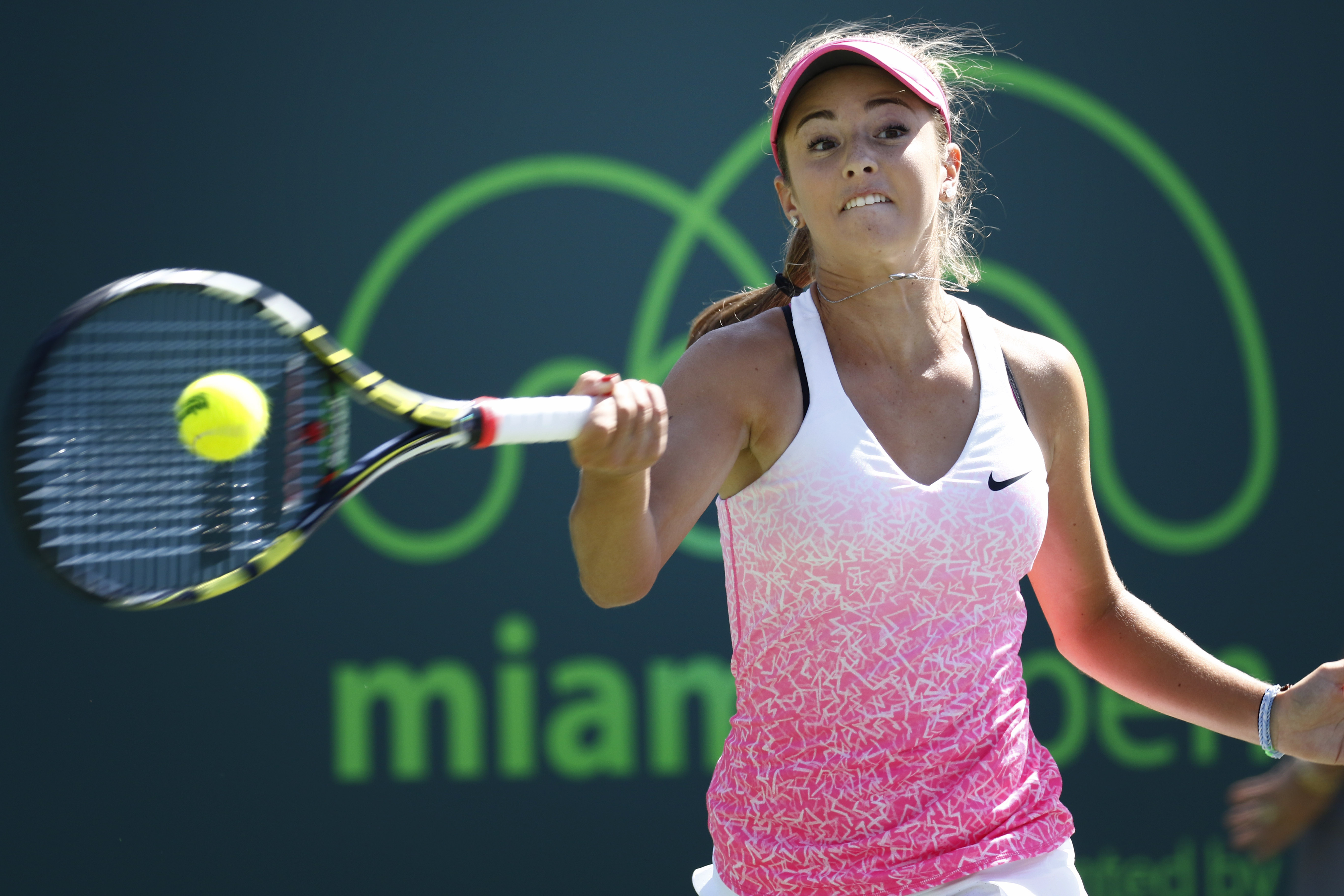 CiCi Bellis returns the ball to Serena Williams during their match at the Miami Open tennis tournament in Key Biscayne, Fla., Sunday, March 29, 2015. (AP Photo/J Pat Carter)