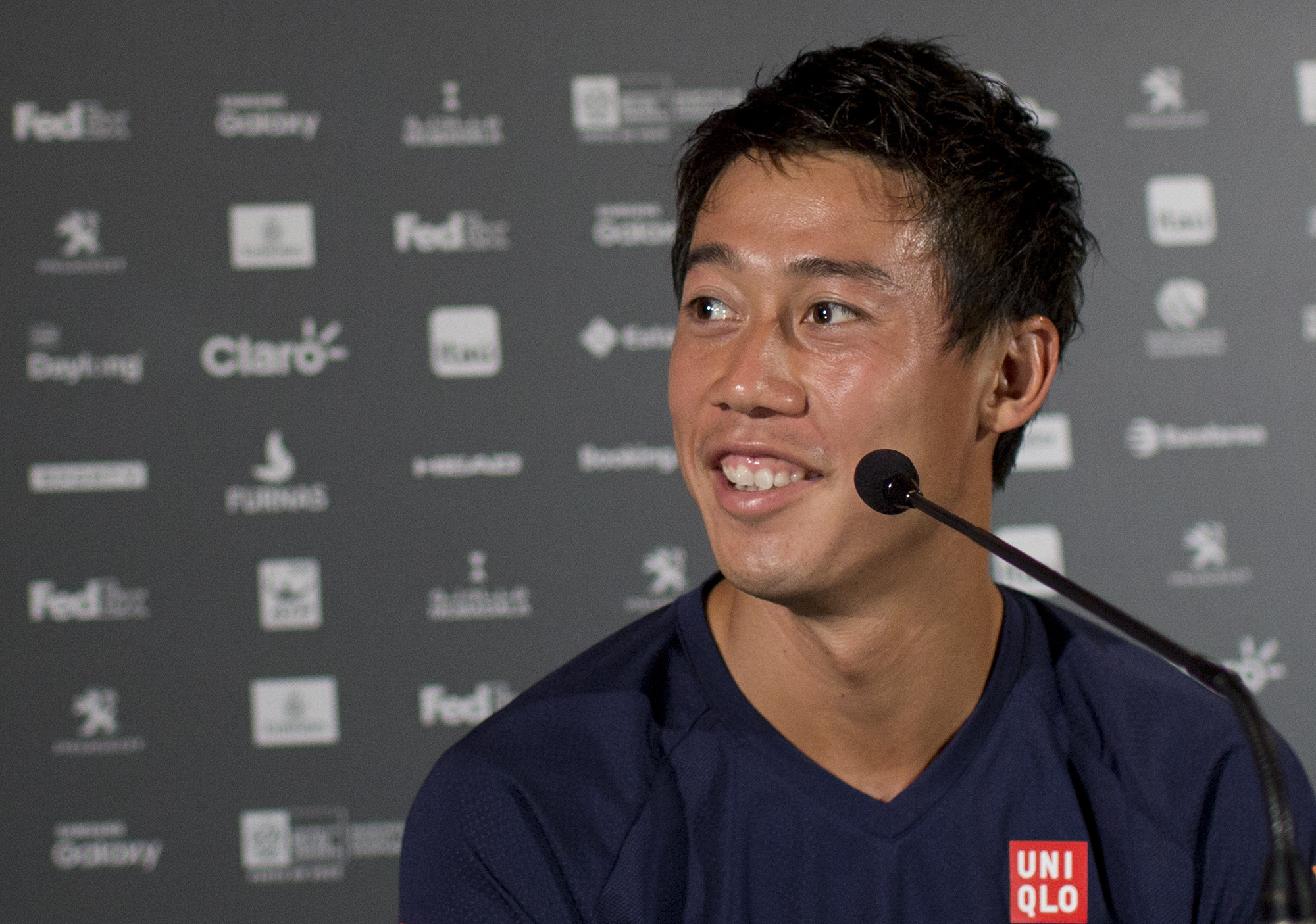 Japan's Kei Nishikori smiles during a press conference at the Rio Open tennis tournament in Rio de Janeiro, Brazil, Monday, Feb. 20, 2017. (AP Photo/Silvia Izquierdo)