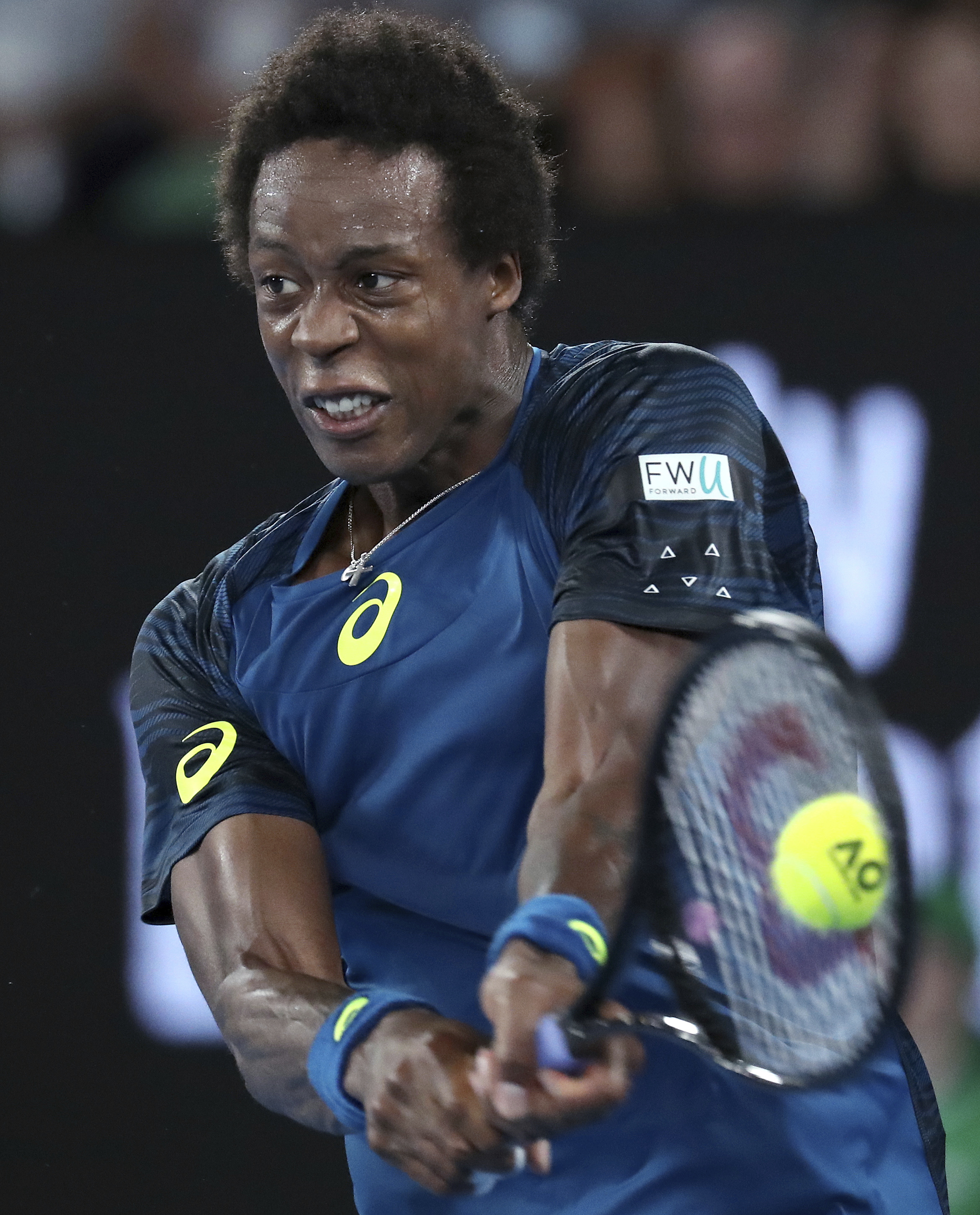 France's Gael Monfils plays a backhand to Spain's Rafael Nadal during their fourth round match at the Australian Open tennis championships in Melbourne, Australia, Monday, Jan. 23, 2017. (AP Photo/Aaron Favila)