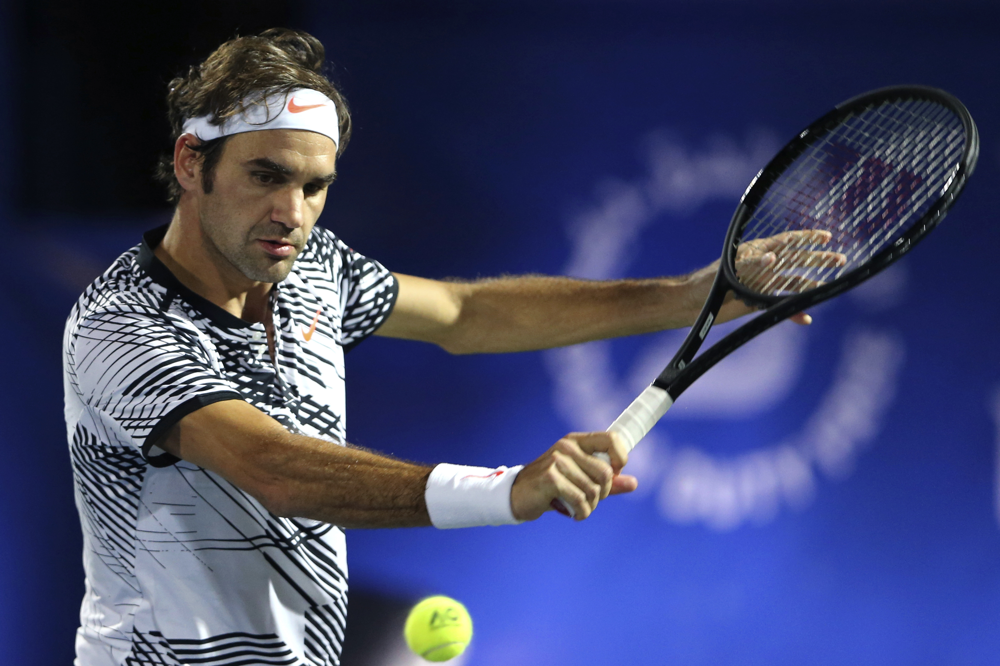 Roger Federer of Switzerland returns the ball to Benoit Paire of France during the Dubai Tennis Championships in Dubai, United Arab Emirates, Monday, Feb. 27, 2017. (AP Photo/Kamran Jebreili)
