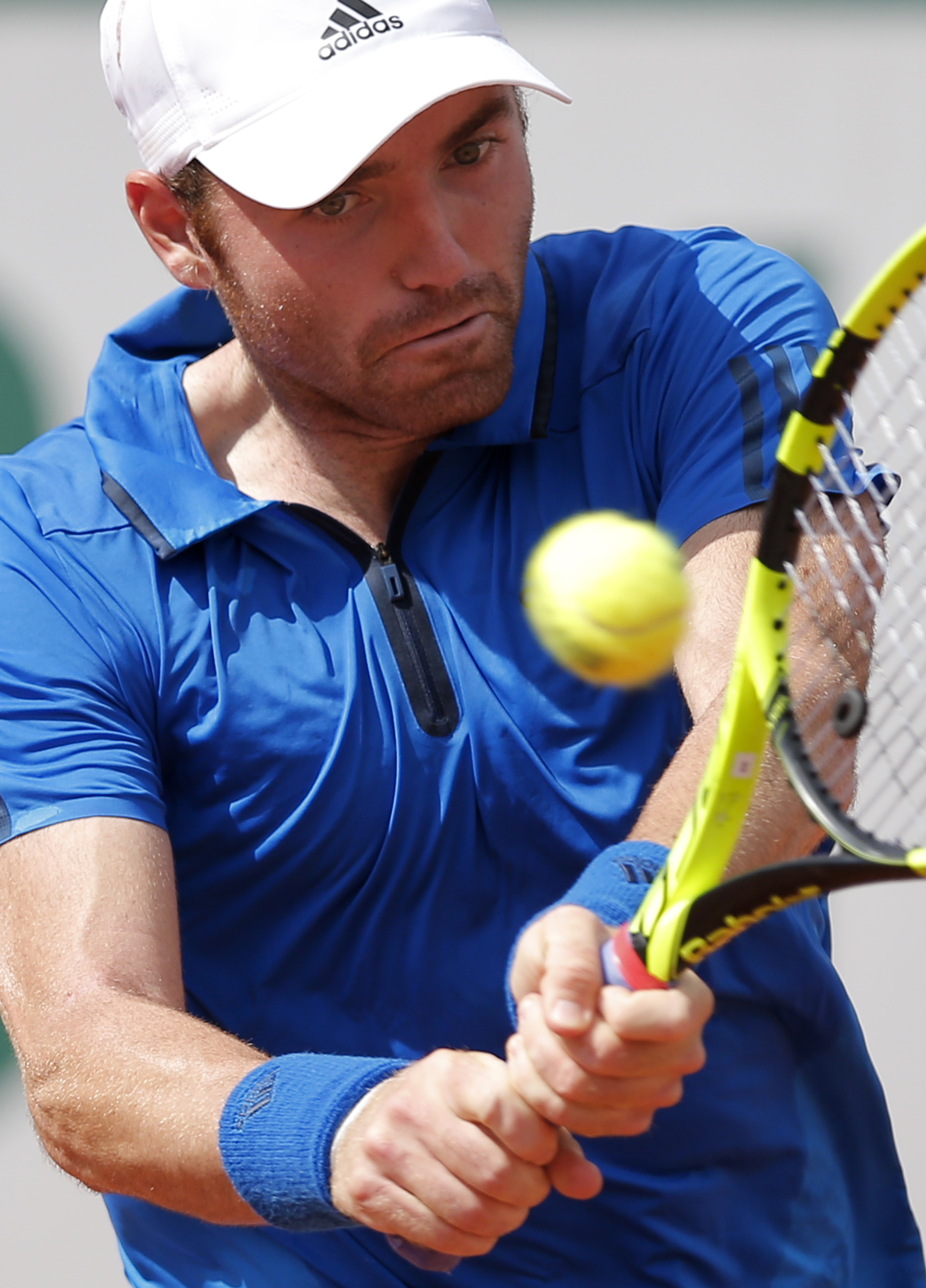 Bjorn Fratangelo of the U.S. returns the ball to France's Richard Gasquet during their second round match of the French Open tennis tournament at the Roland Garros stadium, Wednesday, May 25, 2016 in Paris.  (AP Photo/Christophe Ena)
