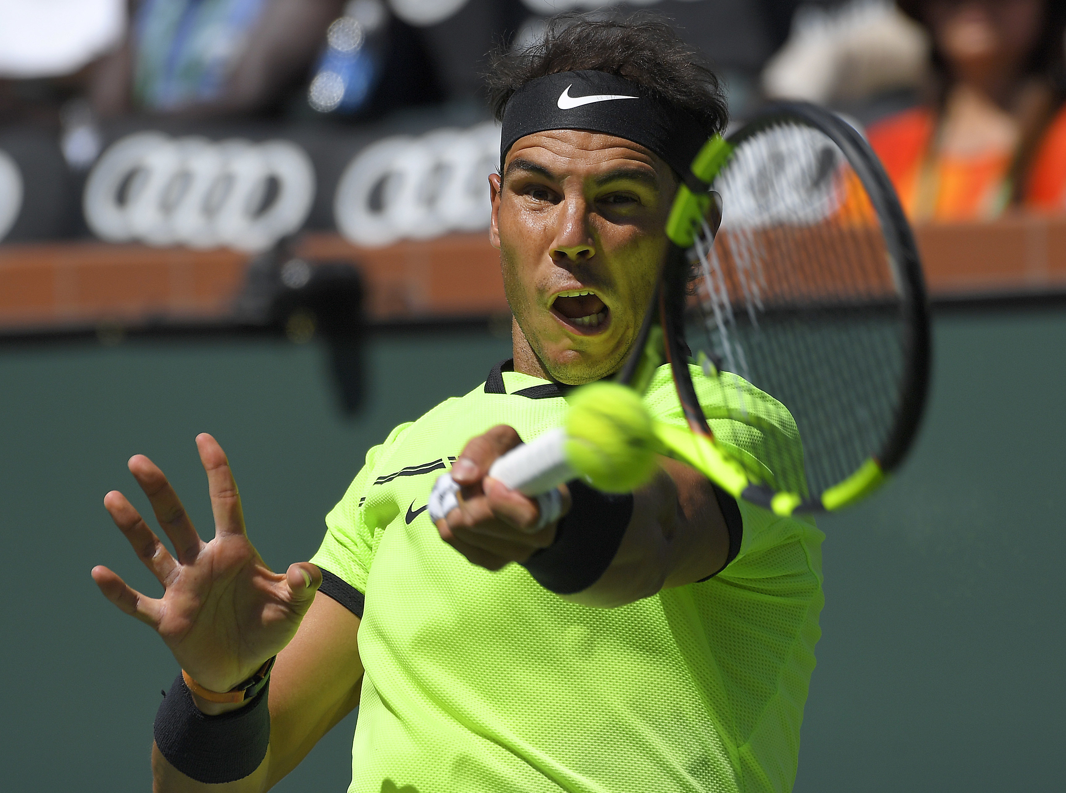 Rafael Nadal, of Spain, returns a shot to Fernando Verdasco, of Spain, at the BNP Paribas Open tennis tournament, Tuesday, March 14, 2017, in Indian Wells, Calif. (AP Photo/Mark J. Terrill)
