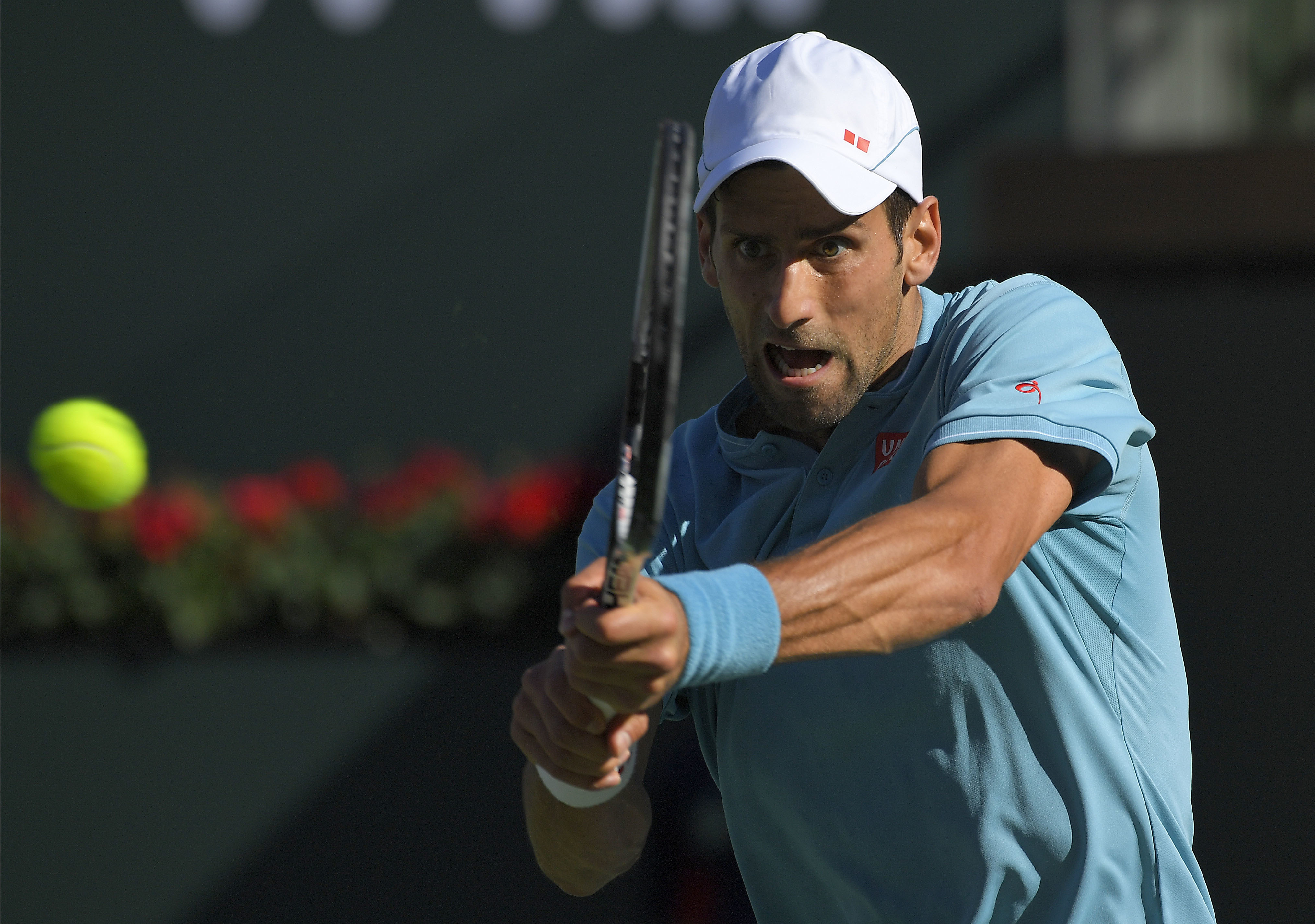 Novak Djokovic, of Serbia, returns a shot to Nick Kyrgios, of Australia, at the BNP Paribas Open tennis tournament, Wednesday, March 15, 2017, in Indian Wells, Calif. (AP Photo/Mark J. Terrill)