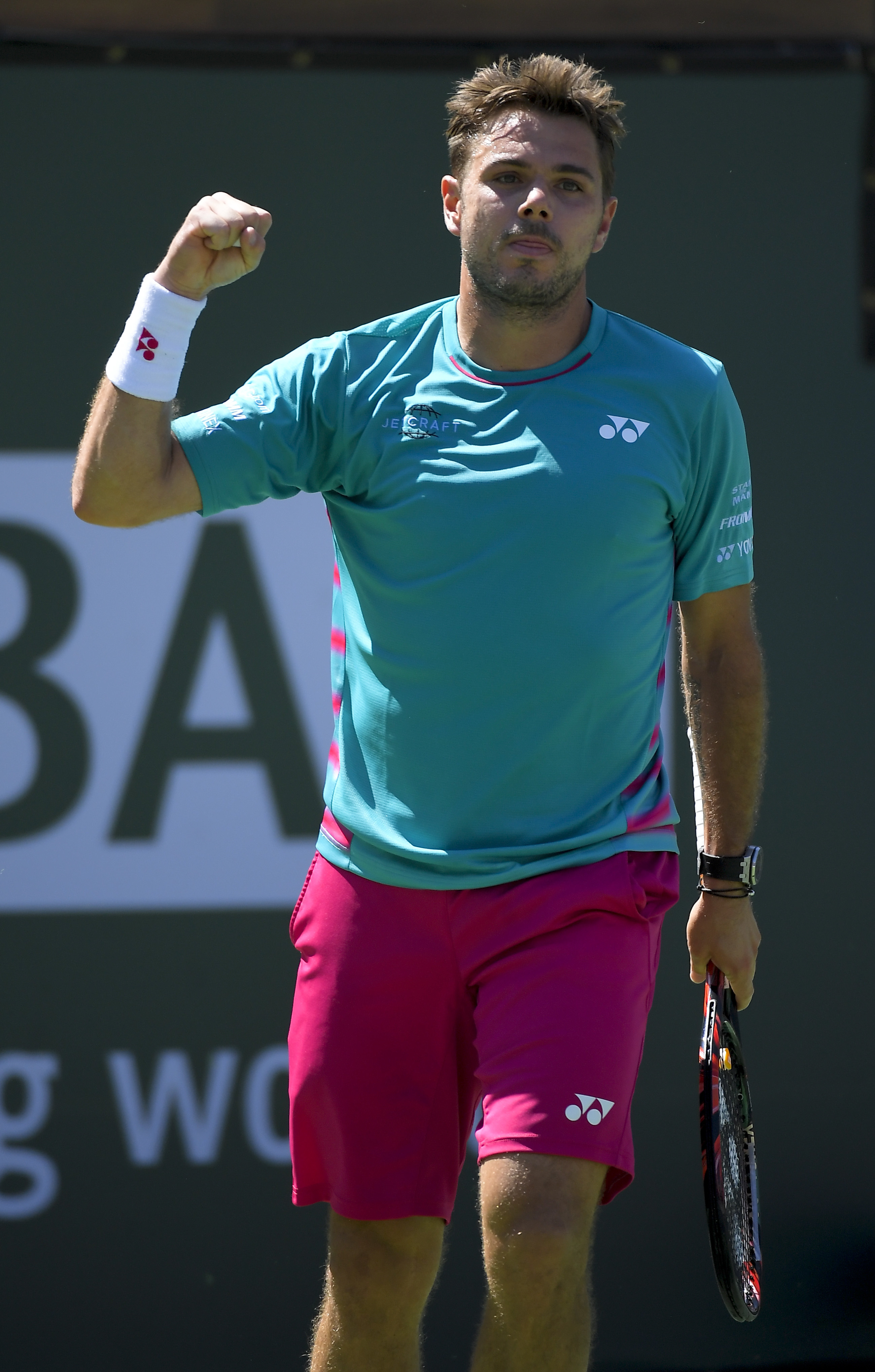 Stanislas Wawrinka, of Switzerland, celebrates beating Pablo Carreno Busta, of Spain, during a semifinal match at the BNP Paribas Open tennis tournament, Saturday, March 18, 2017, in Indian Wells, Calif. (AP Photo/Mark J. Terrill)