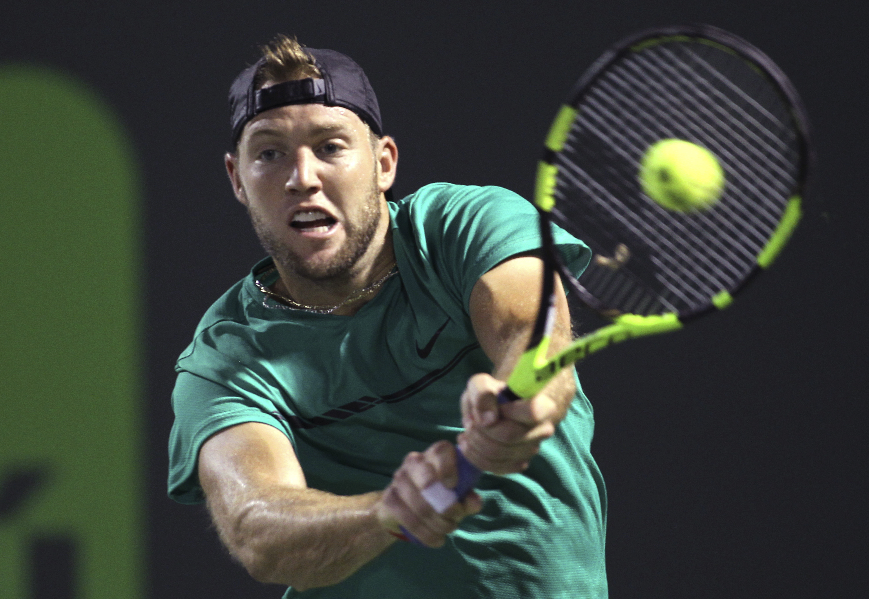 Jack Sock, of the United States, hits a return to Jiri Vesely, of the Czech Republic, during the Miami Open tennis tournament, Sunday, March 26, 2017, in Key Biscayne, Fla. Sock won 6-3, 7-6(0). (AP Photo/Luis M. Alvarez)